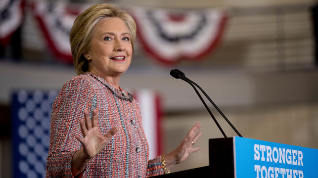 Clinton back campaigning after pneumonia scare