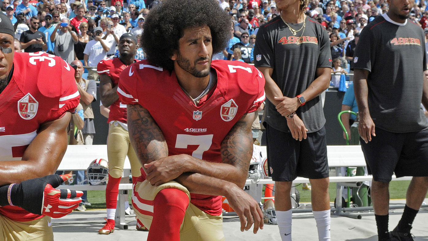 Colin Kaepernick kneels during the US national anthem. (Getty)