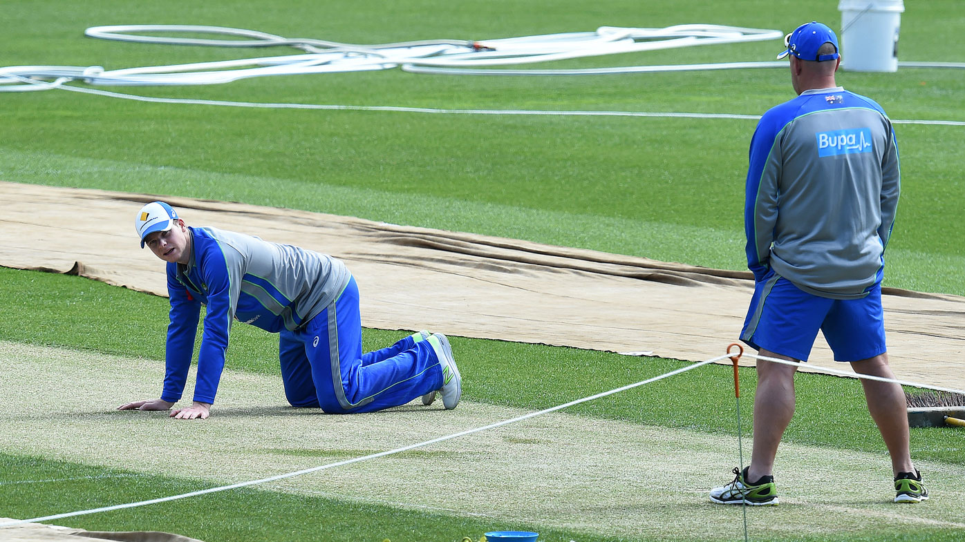Steve Smith inspects the wicket at Bellerive Oval. (AAP)