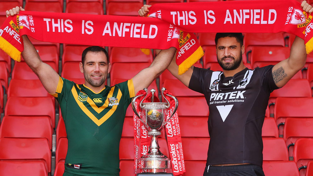 Cameron Smith and Jesse Bromwich stand in the iconic Kop stand. (Getty)