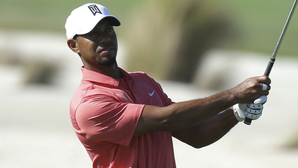 Tiger Woods returns with round of 73