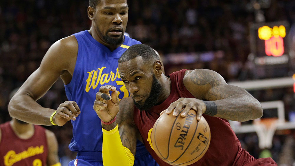 Irving clutch again as Cavs down Warriors