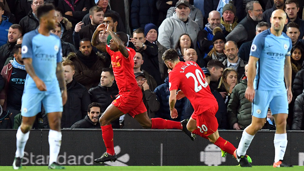 Liverpool win to keep touch with Chelsea