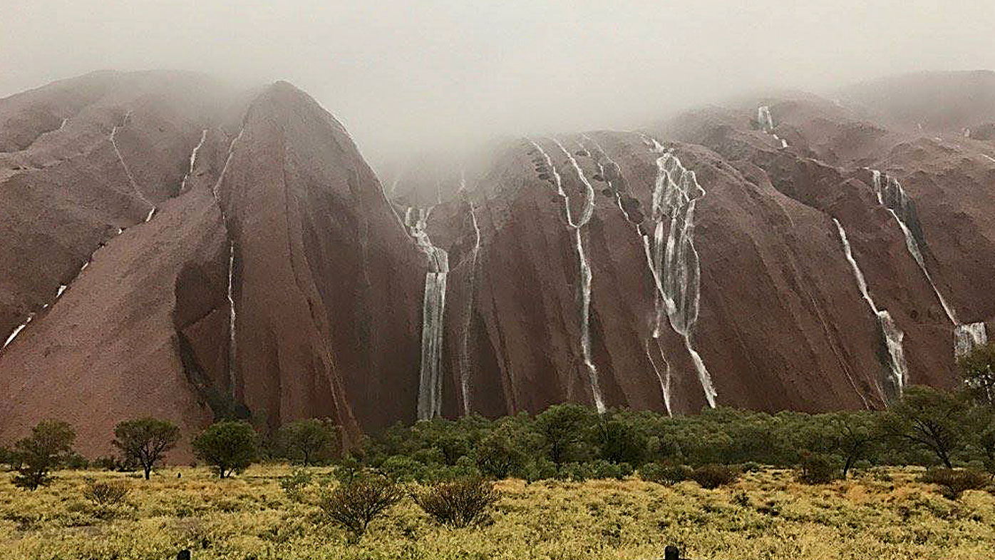 Rain falls on Uluru on Boxing Day in 2016. (Uluṟu-Kata Tjuṯa National Park)