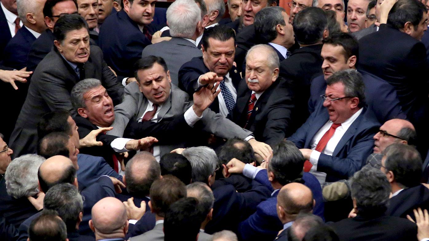 Turkey president Erdogan rebukes MPs over 'leg-biting' brawl in parliament