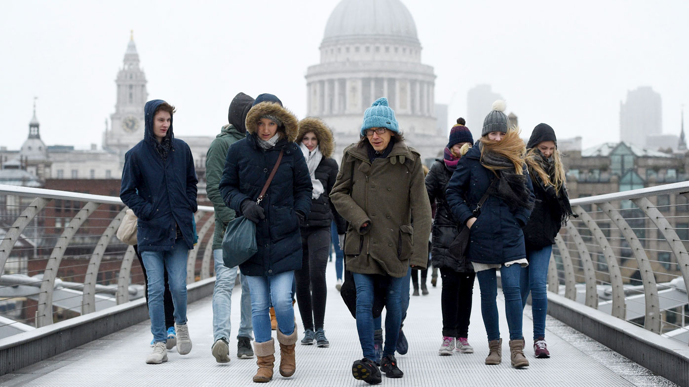 Winter storm batters Europe, killing two, as snow falls in London