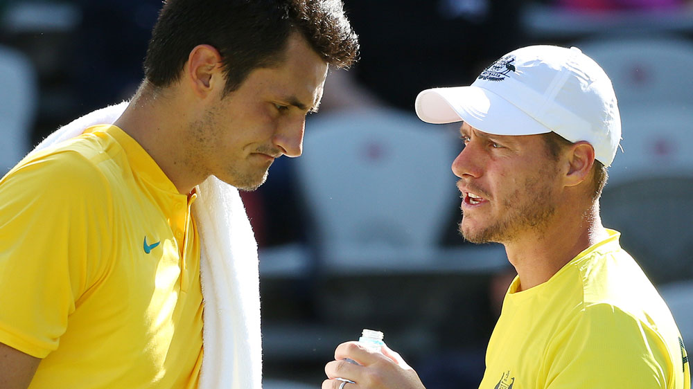 Bernard Tomic and Lleyton Hewitt. (AAP)
