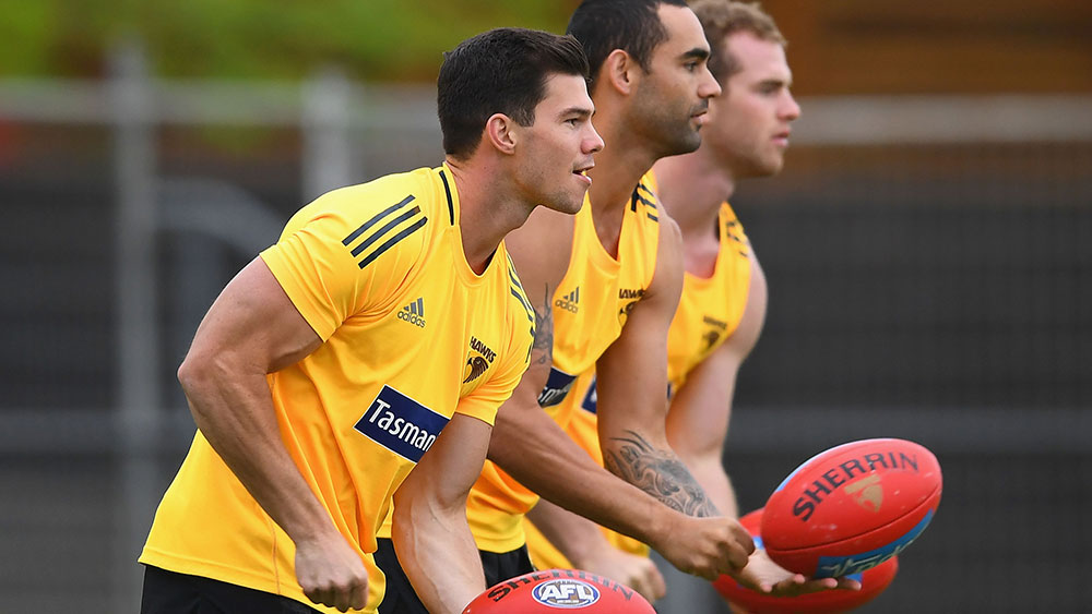 Jaegar O'Meara, Shaun Burgoyne and Tom Mitchell. (Getty)