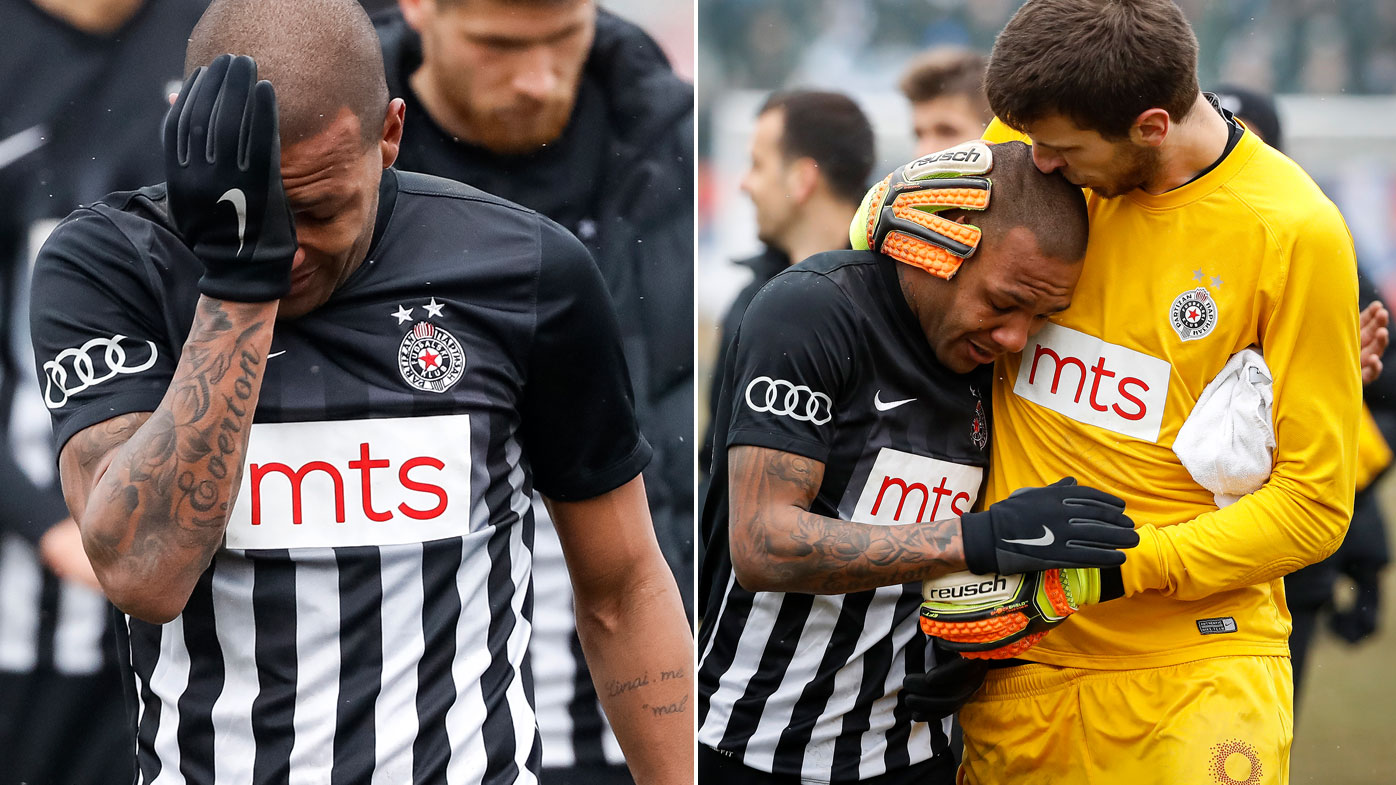 Footballer Everton Luiz leaves the field in tears after being subjected to racial abuse. (AFP)