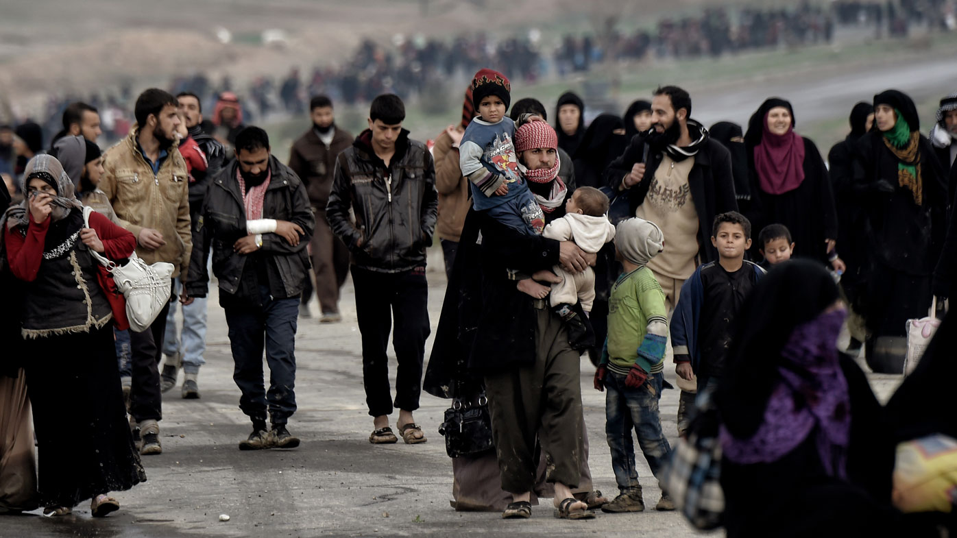 Hungry but happy, some begged for food as they rejoiced in fleeing the clutches of Islamic State. (AFP)