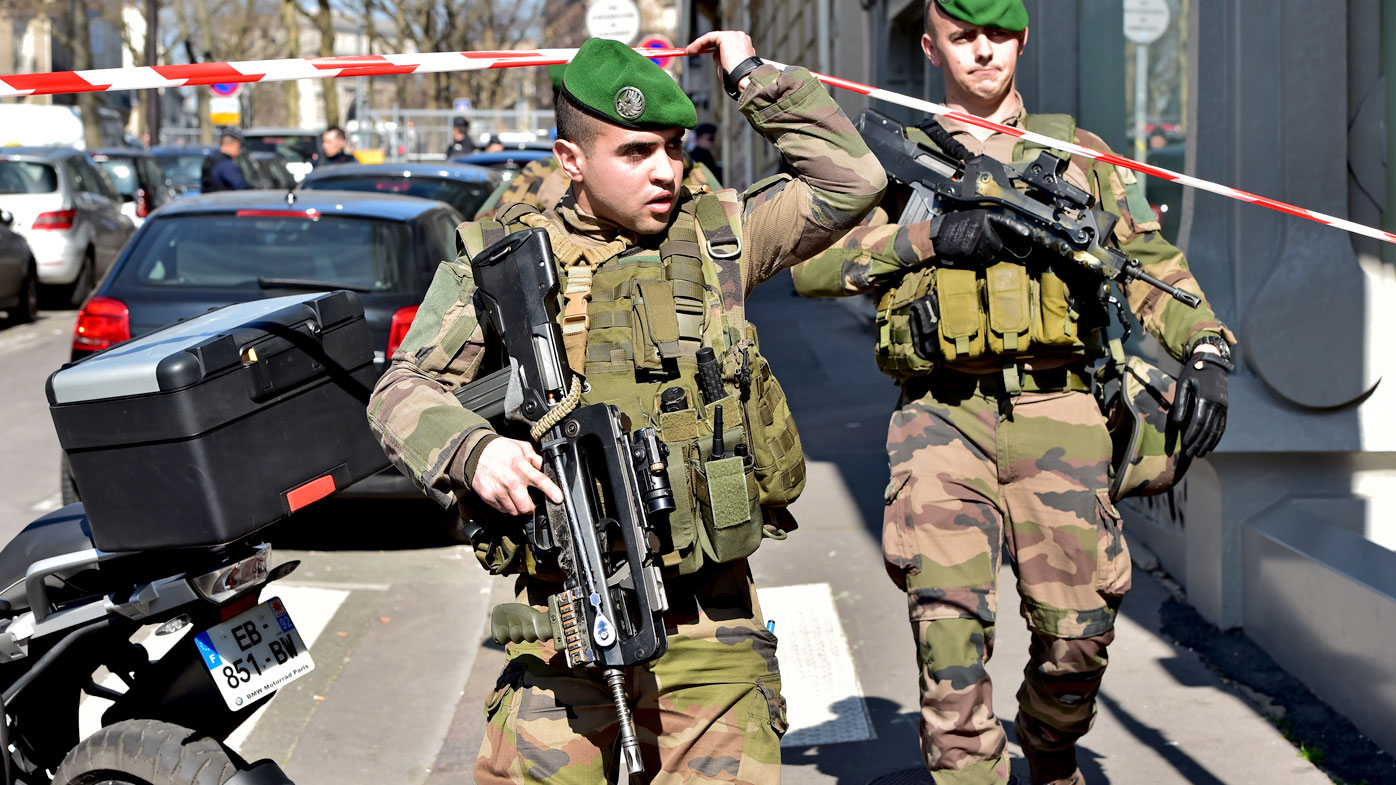 French Army soldiers arrive at the scene of the Paris offices of the International Monetary Fund. (AFP)