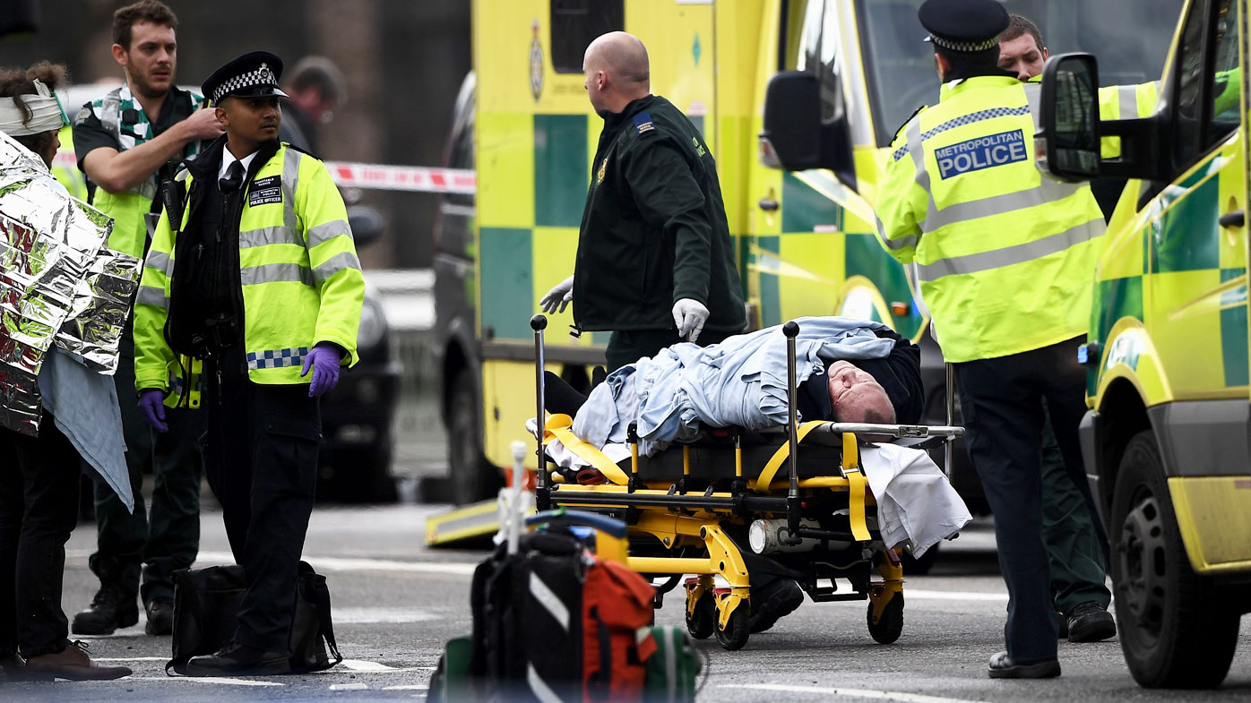 A person is taken away on a stretcher outside Westminster Palace. (Getty)