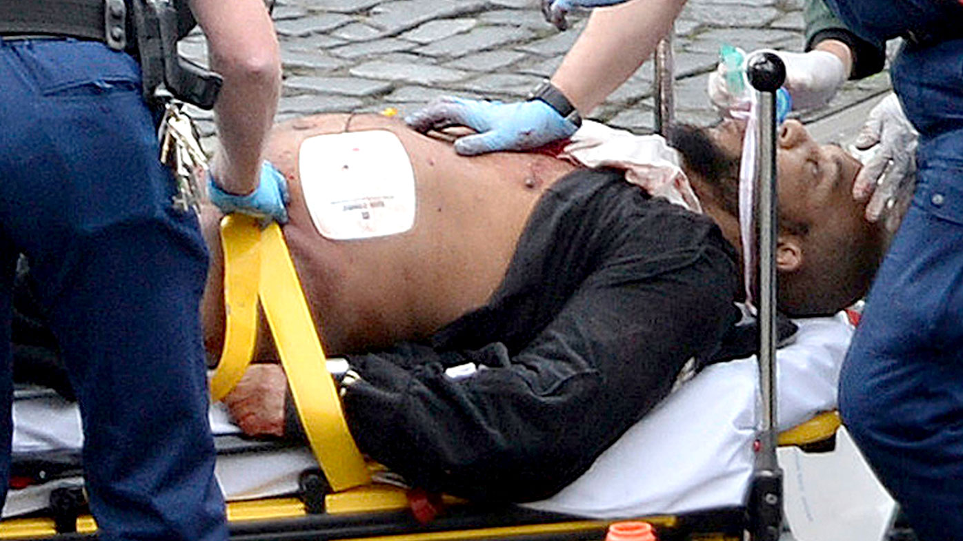 Khalid Masood is treated by paramedics after being shot as he attacked police officers outside London parliament. (AAP)