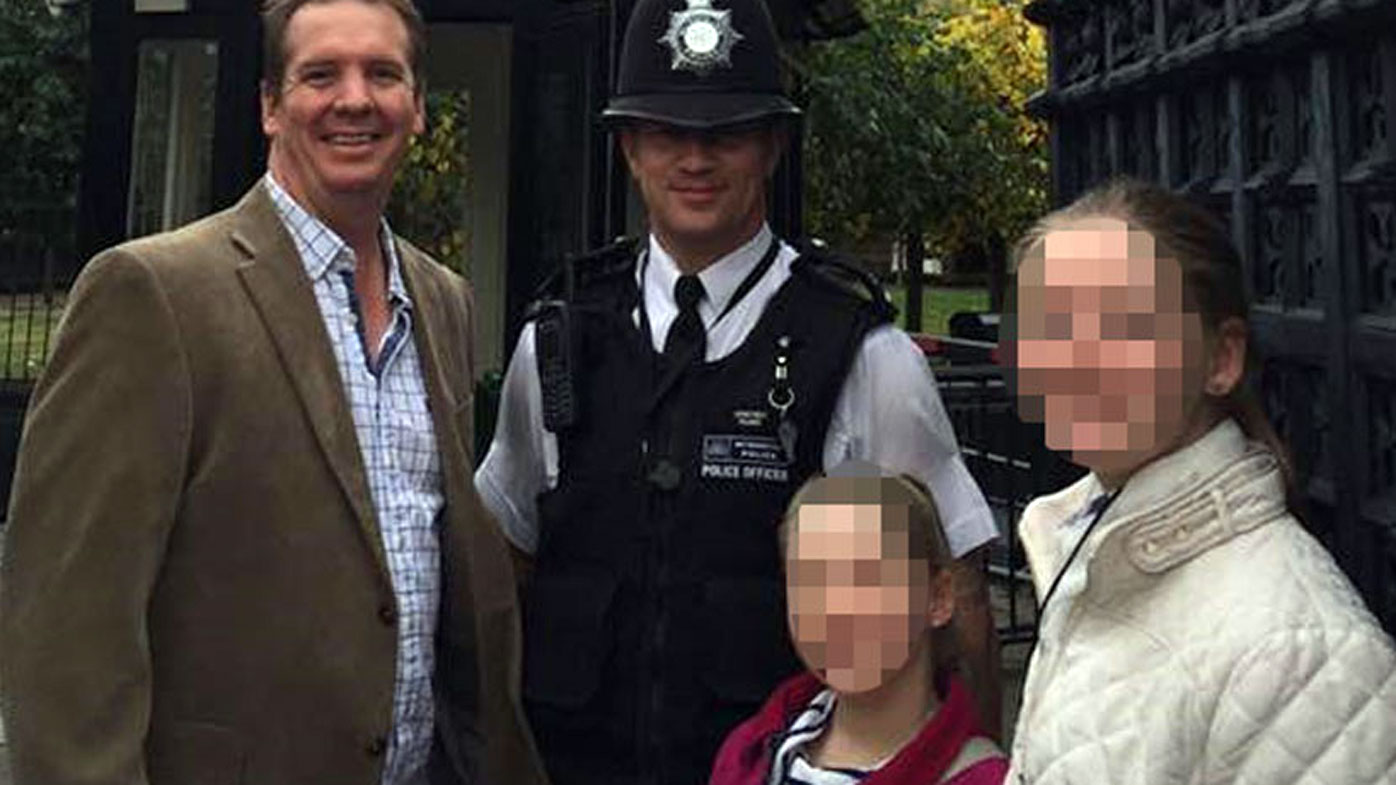 An unknown family pose with PC Keith Palmer.