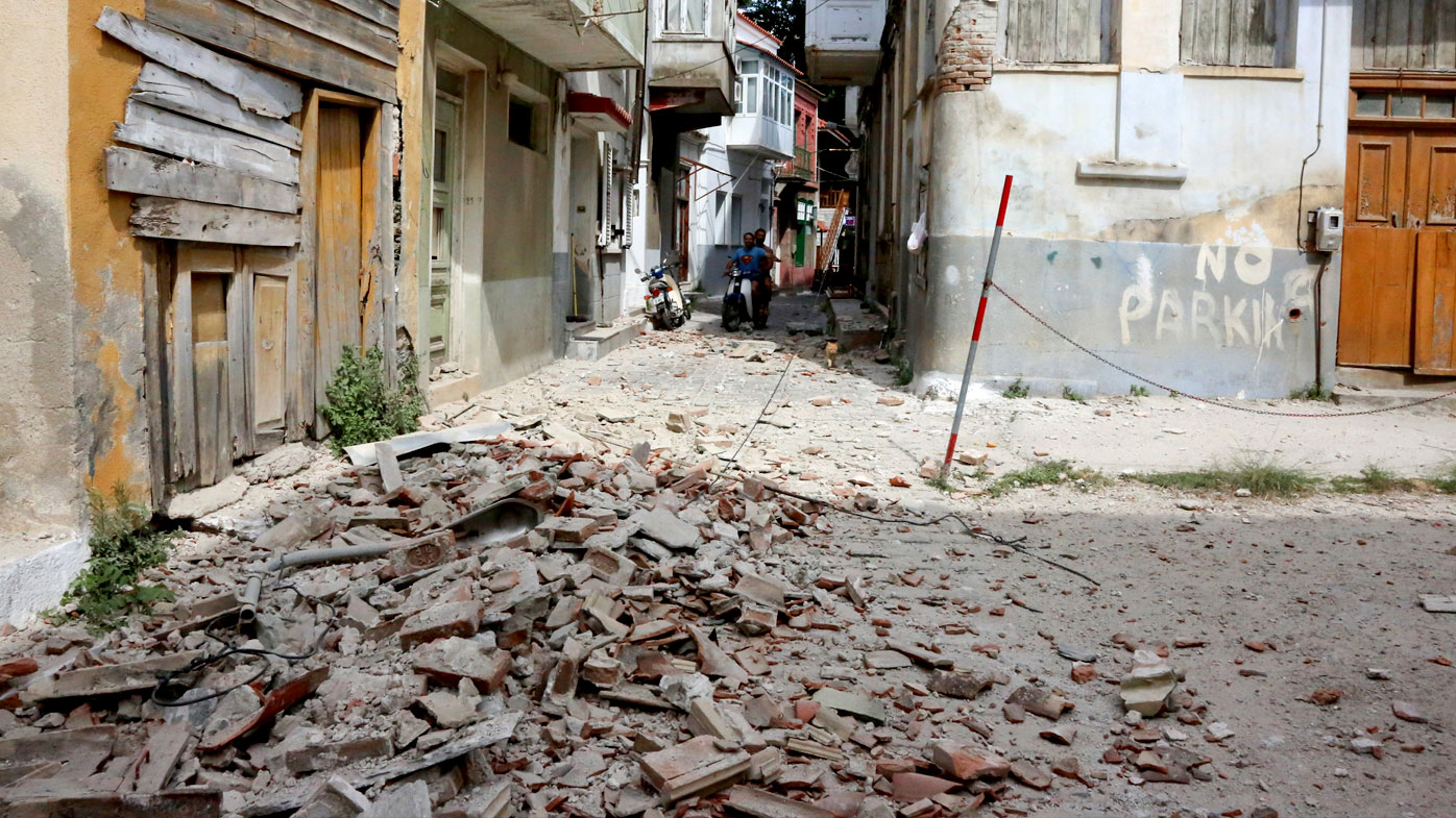 The debris of a damaged building after an earthquake in the village of Plomari on the northeastern Greek island of Lesbos. (AAP)