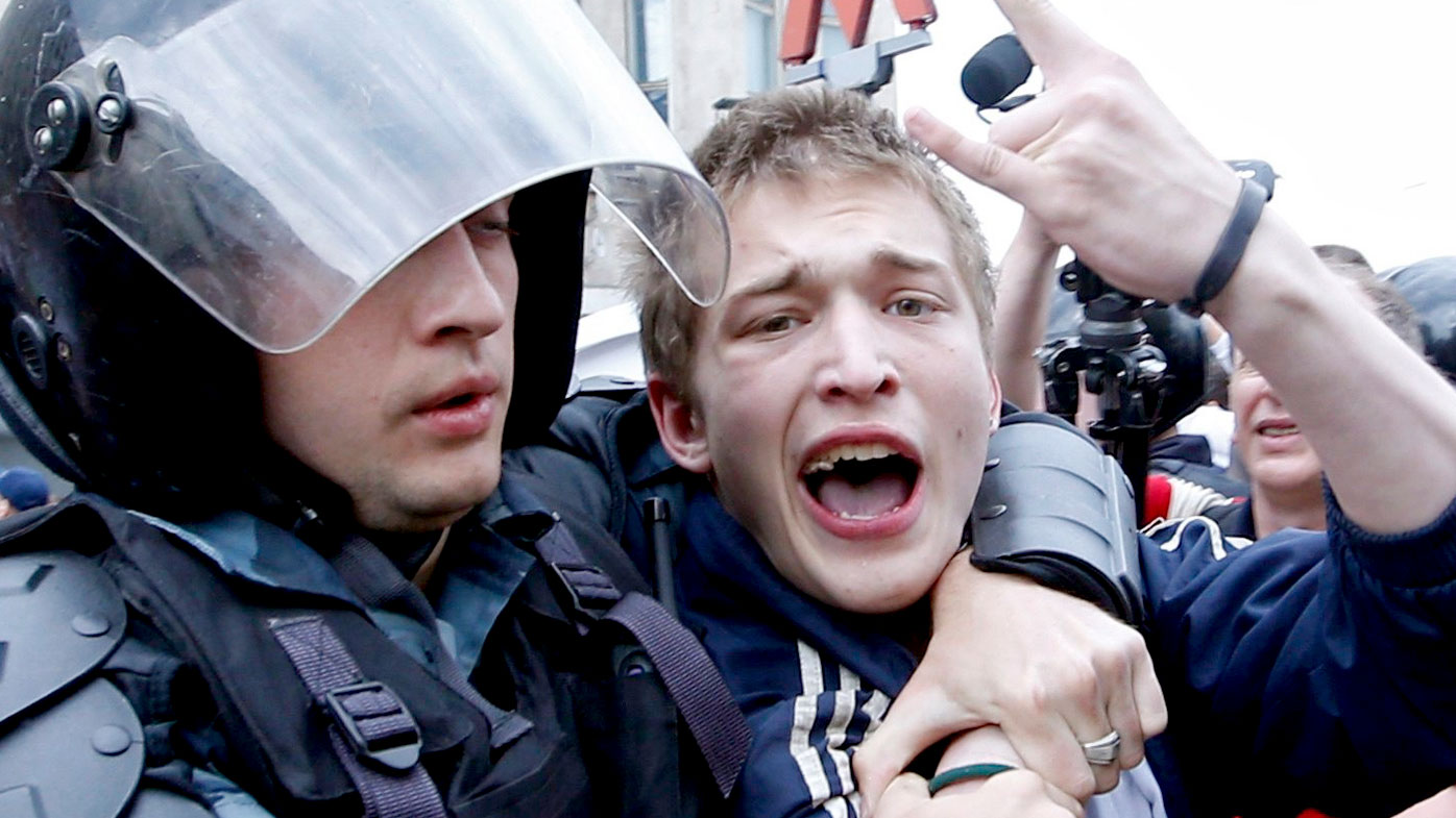 Russian police officers detain a participant of an unauthorised opposition rally in Tverskaya street in central Moscow, Russia. (AAP)