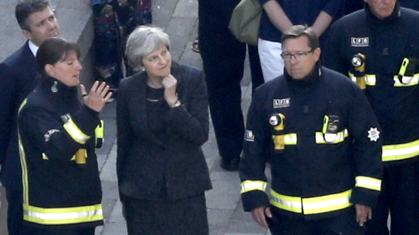 Prime Minister Theresa May visits emergency services at the scene of the fatal fire. (AFP)