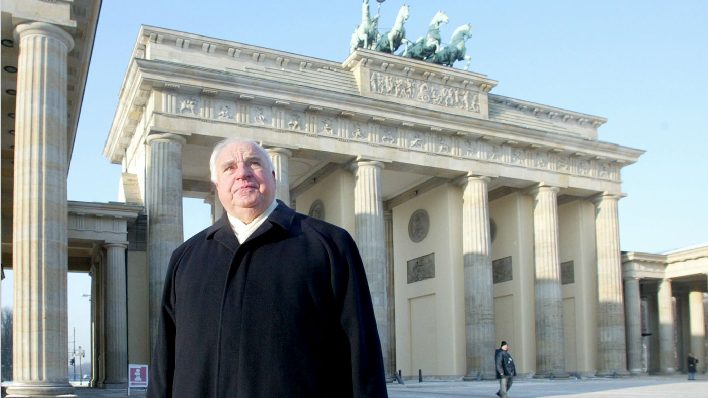 Former German chancellor Helmut Kohl passing the Brandenburg Gate during a private walk in Berlin. (AAP)