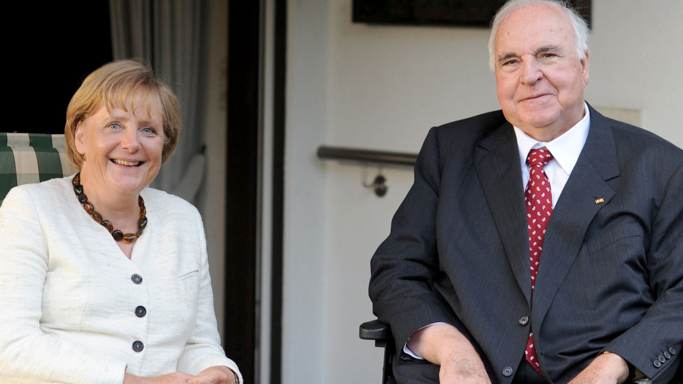 German Chancellor Angela Merkel and former chancellor Helmut Kohl meet for a chat in Kohl's house in Ludwigshafen, Germany. (AAP)
