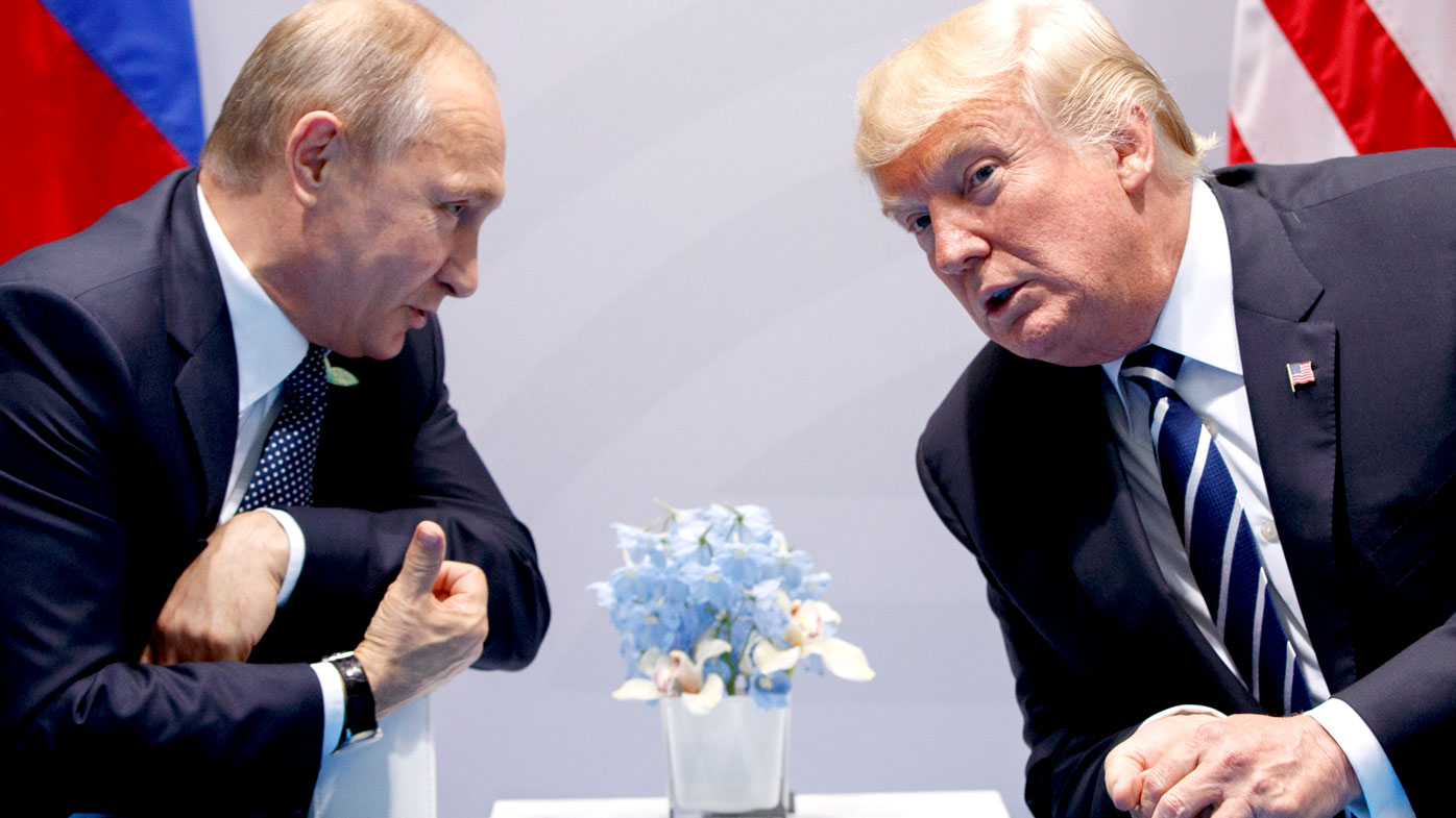 Vladimir Putin whispers to Donald Trump as the pair prepare to discuss 'very positive things'. (AAP)