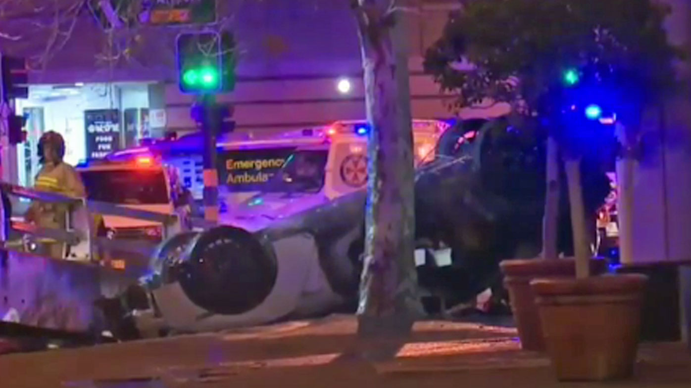 Three people have been killed in a fiery car accident in Sydney's CBD.