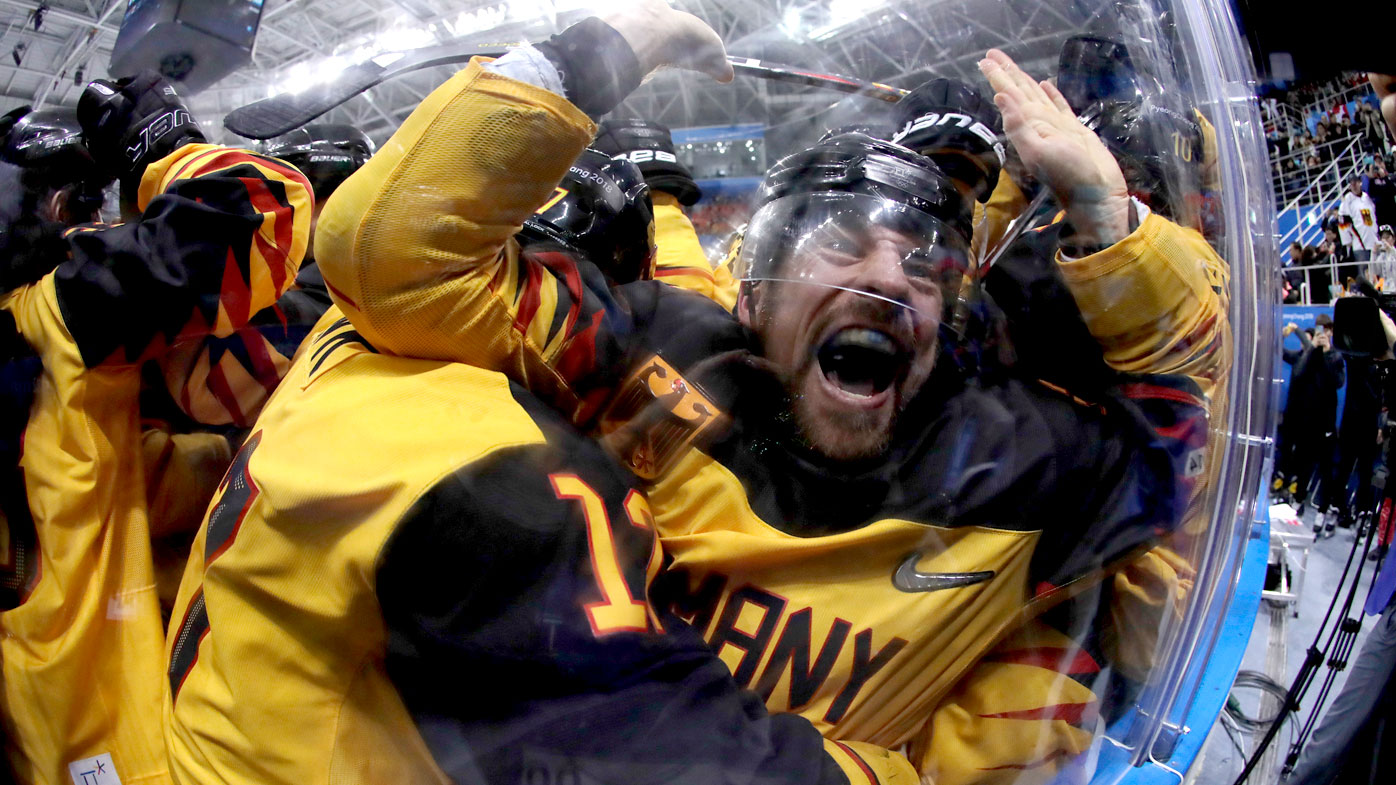 Germany celebrate after defeating Canada in the men's ice hockey at the PyeongChang Winter Olympics. (AAP)