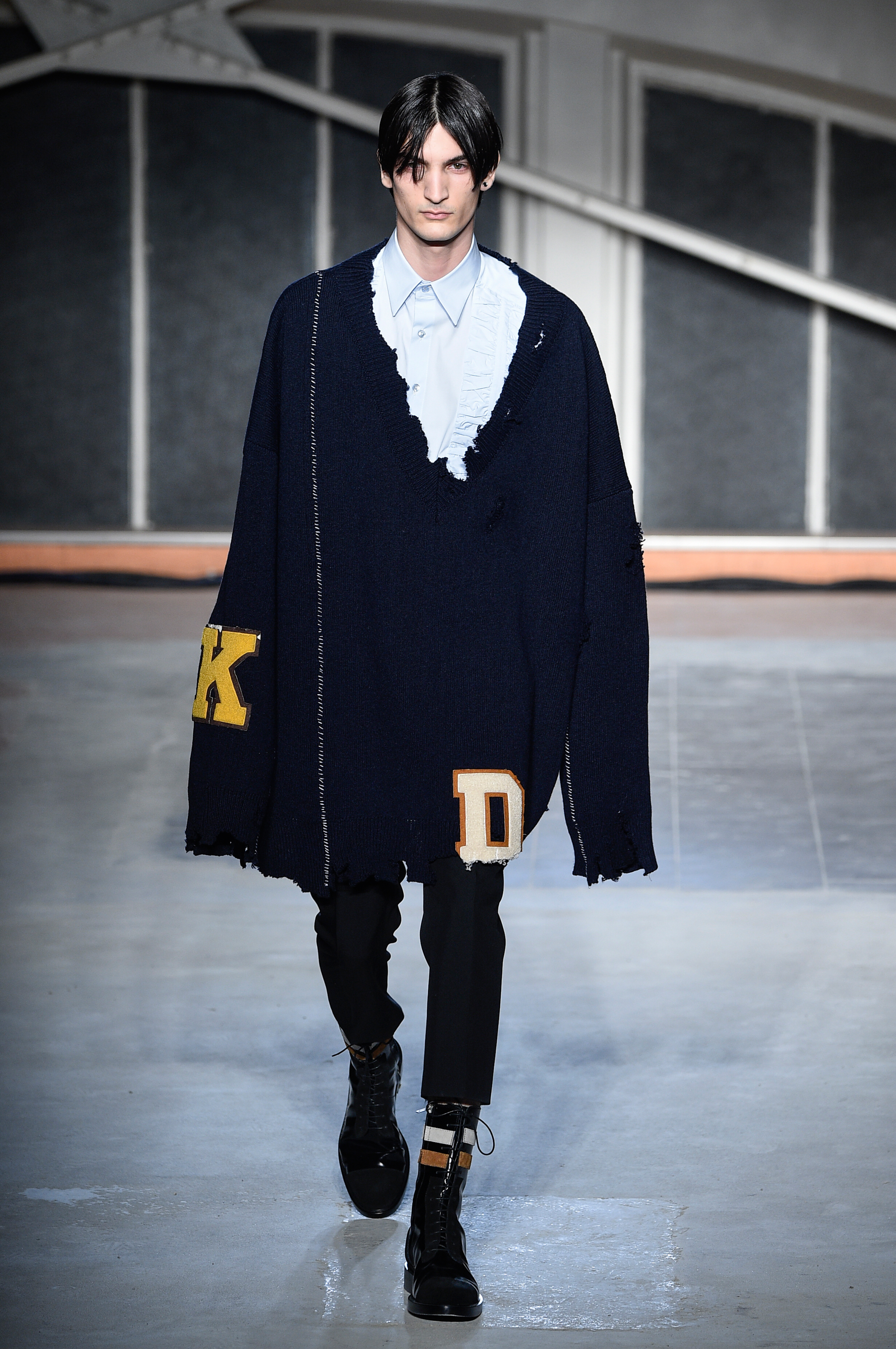 """Debuting his first collection since leaving Dior, Raf Simons continued his love affair with proportion with a runway of oversized knits, sweaters and jackets that abide by the motto """"go big or go home""""."""
