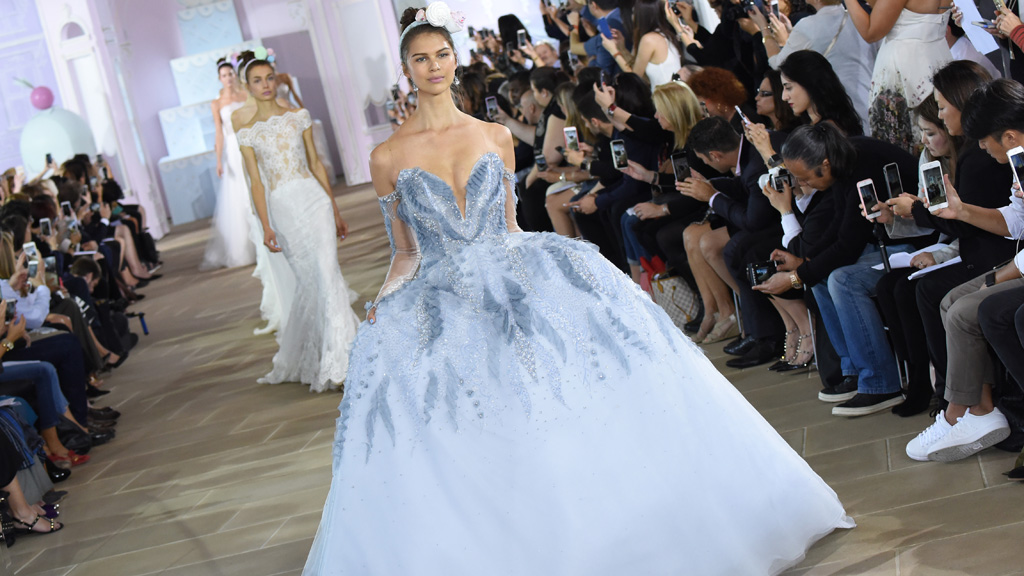"""Most romantically-inclined potential brides dream of a white wedding but designers at <a href=""""http://honey.nine.com.au/2016/10/07/11/30/bridal-fashion-week-wedding-dress-new-york"""" target=""""_blank"""">New York Bridal Fashion Week</a> are getting more colourful with their creations. <br /> The majority of dresses are white meringues, mermaid gowns or slinky '20s numbers but sneaking down the aisle are colourful gowns to offer an emotive alternative to people who feel uncomfortable with white's pure connotations. <br /> One of Australia's leading celebrity stylists Ken Thompson, who has worked with Kylie Minogue, Eva Longoria and Shannen Doherty, is all for making that something blue on the big day your dress.<br /> """"It's a celebration,"""" Thompson says. """"Embrace colour, especially for a summer wedding. What could be more joyous busting out of the monochrome mode.<br /> """"Sparky citrus hues will give a Pantone paradise without screaming school formal. Plains are a must though.""""<br /> Thompson's advice extends to the bridal party. """"Make sure that the whole group is tonal. It's also a great excuse for a groom to bust out of a penguin suit and enjoy the day in an unstructured cream linen suit."""""""