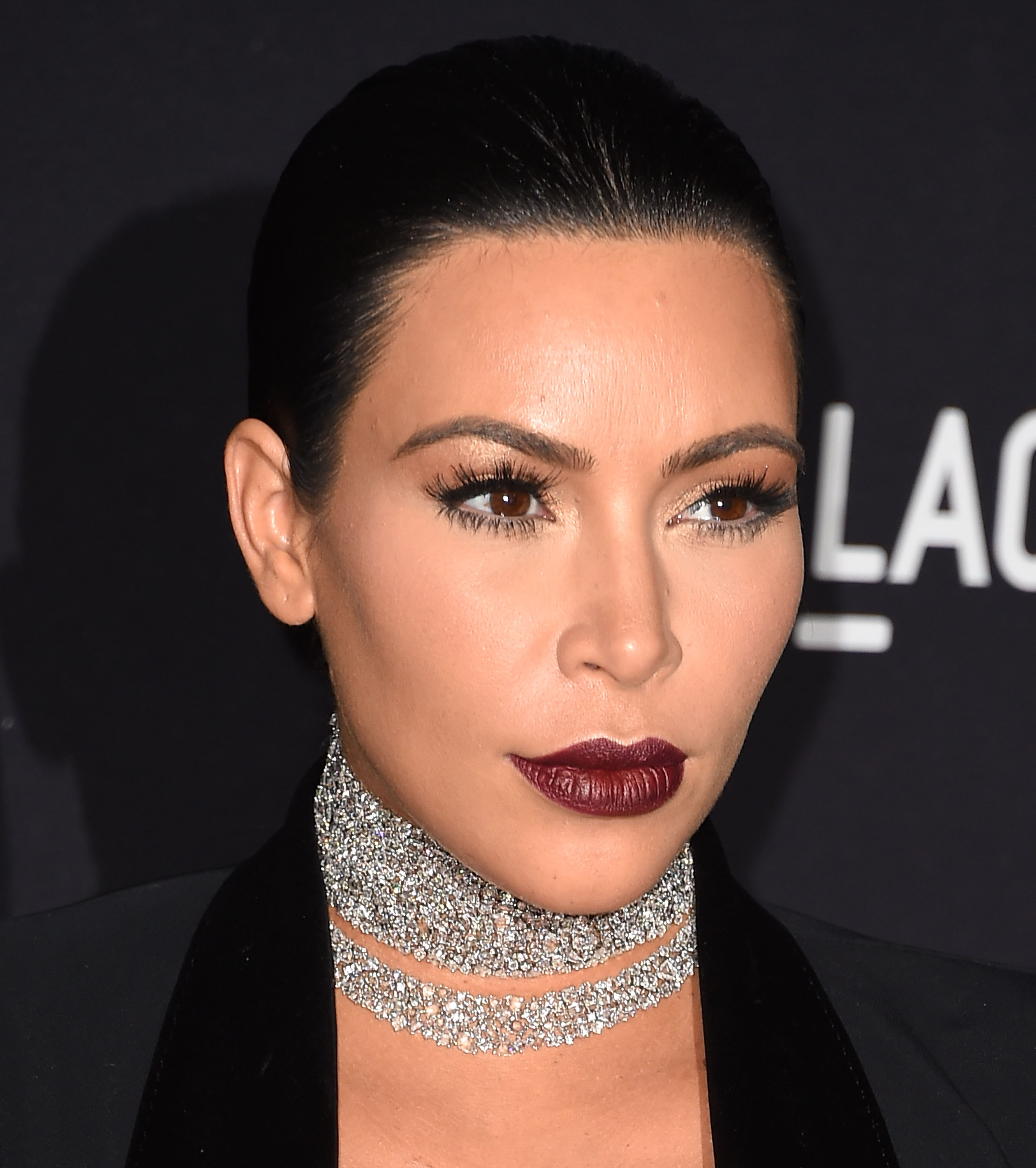 "<p>You might be inclined to reach for classic red lippie this party season, but stop for a season refresh. The sexy statement lip this time around is much, much darker than the last time you pulled a cracker. Just check out Kim Kardashian's gothic glam lip here.</p> <p>From runways to red carpets it's all about the rouge-noir lip, from deep plum to matte magenta. At Atelier Versace in Milan, models wowed with glittered ombre lips in rich berry while the lip stains at Antonio Marras were pressed on and plum-coloured. </p> <p>So how do you skip looking like a '90s goth gone wrong?  First up, keep the rest of your makeup  minimal - that means no blush or bright eyeshadows. Secondly, ditch pale, velvety foundation for a modern finish of second-skin honey-hued dewy. </p> <p>""When wearing a dark lip, whether matte or glossy, don't have a lot of other products on the face,"" says <a href=""https://www.instagram.com/carol_mackie/"" target=""_blank"">Carol Mackie</a>, Senior Artist, M.A.C Cosmetics. ""And don't perfect your lip straight away. Just get the product on then shape and tidy with lip liner."" For a modern finish, Mackie recommends starting with  M.A.C Lip Mix, which hug the lips, then slicking with gloss. </p> <p> Swipe through our gallery to get some Bordeaux lip inspo plus our plum product picks of the season.</p>"