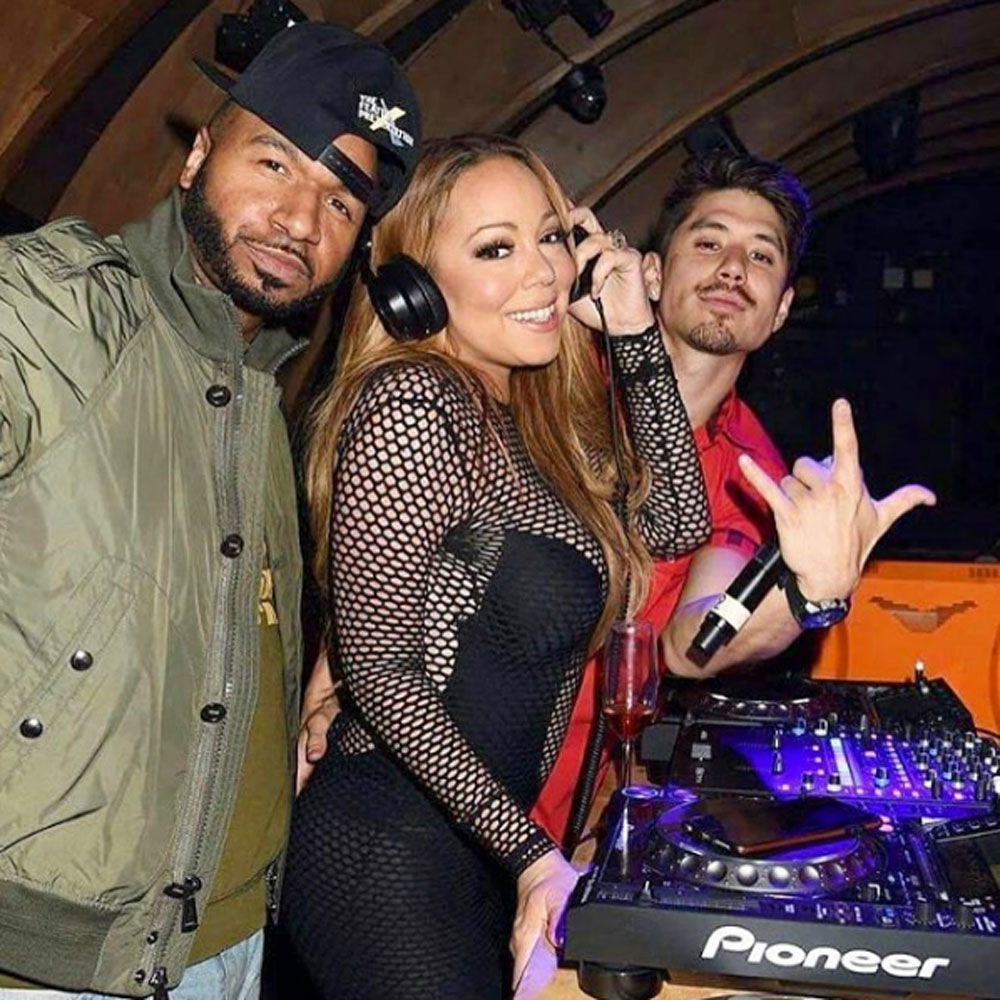 Mariah Carey has been spotted smooching her backup dancer Bryan Tanaka