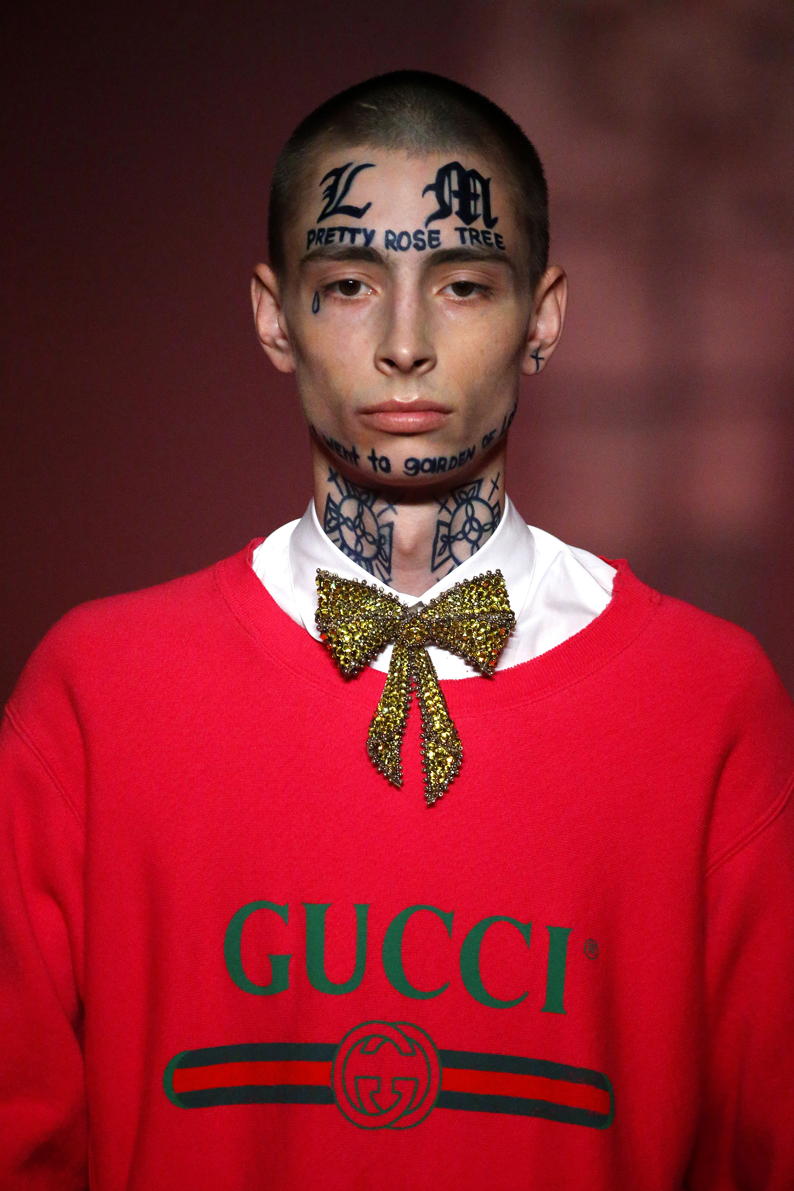 "<p>The star of Gucci's spring/summer '17 campaign boasts more than sculpted cheekbones and piercing eyes.</p> <p>Latvian model Lorens caused a stir on the runway at the Gucci show at <a href=""https://style.nine.com.au/2015/09/24/09/32/gucci-ss16-runway"" target=""_blank"">Milan Fashion Week</a> in September with William Blake quotations tattooed across his face.</p> <p>The bold look earned the shy 18-year-old pride of place in the Italian label's latest campaign photographed by Glen Luchford. The shoot takes place in creative director Alessandro Michele's home town of Rome.</p> <p>Away from the Gucci fairy dust Lorens is slightly less intimidating, with the tattoos washing off to reveal a face any mother could love.</p> <p>The campaign, which also features tigers, lions and the Trevi Fountain will debut on January 1.</p> <p>See the Gucci campaign images here, along with other, more permanent, fashion ink.</p> <p> </p>"