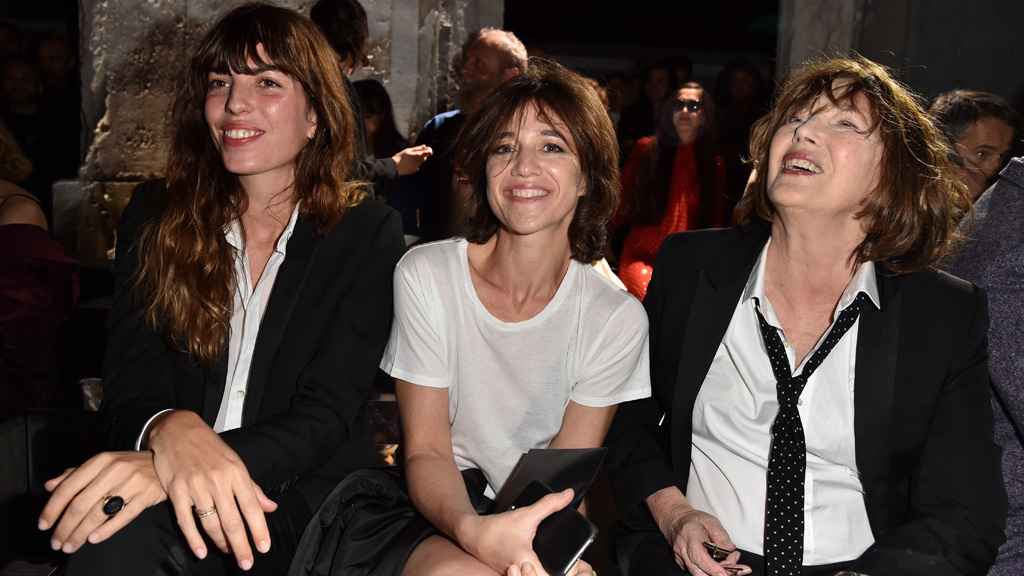 Lou Doillon, Charlotte Gainsbourg and Jane Birkin front row Paris Fashion Week. Image: Getty.