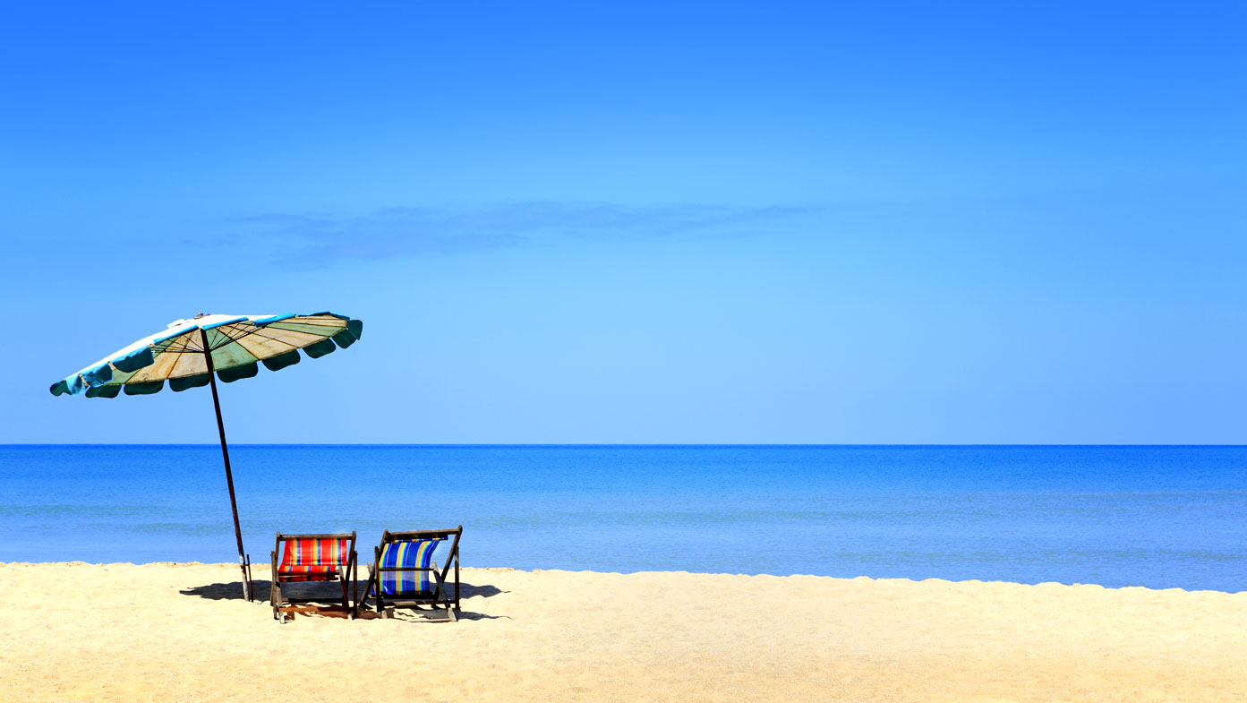A beach umbrella alone isn't going to protect you from sunburn