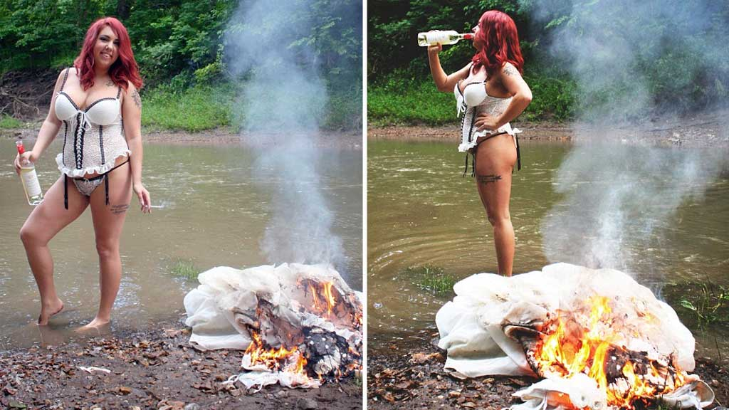 Katlynn McKee drinks wine from the bottle as her wedding dress goes up in flames. (Caters News Agency)