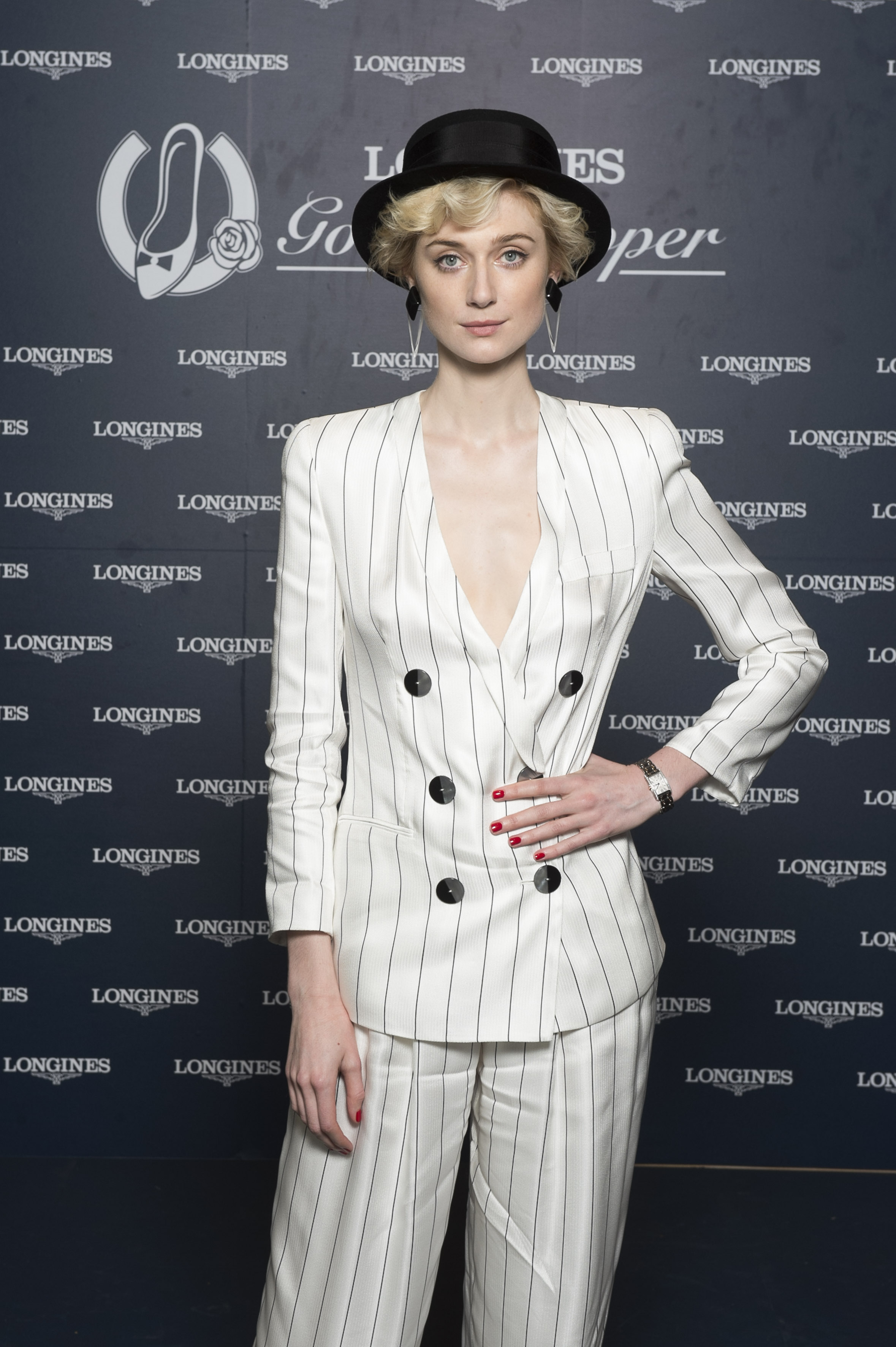<p>Prestigious Swiss watchmaker, Longines, entered the autumn racing carnival in style over the weekend, hosting a luncheon in the Grand Pavilion at Rosehill Gardens Racecourse. </p> <p>Actress Elizabeth Debicki from The Man From Uncle, who is the brand's Golden Slipper ambassador, played hostess to a bevy of high profile guests who were attending in celebration of the lucrative race. </p> <p> Among the line-up of guests were radio host Emma Freedman, media identities Laura Dundovic and Nikki Philips , I'm a Celebrity … Get me out of here! contestant Tegan Martin and racing personality Tom Waterhouse, all shining on the red carpet. Showing off an array of ensembles, from striking red dresses, eye-catching hats and pinstripe pant suits, they definitely set the tone in the style stakes for autumn racing.</p> <p>Longines Golden Slipper ambassador, Elizabeth Debicki.</p>