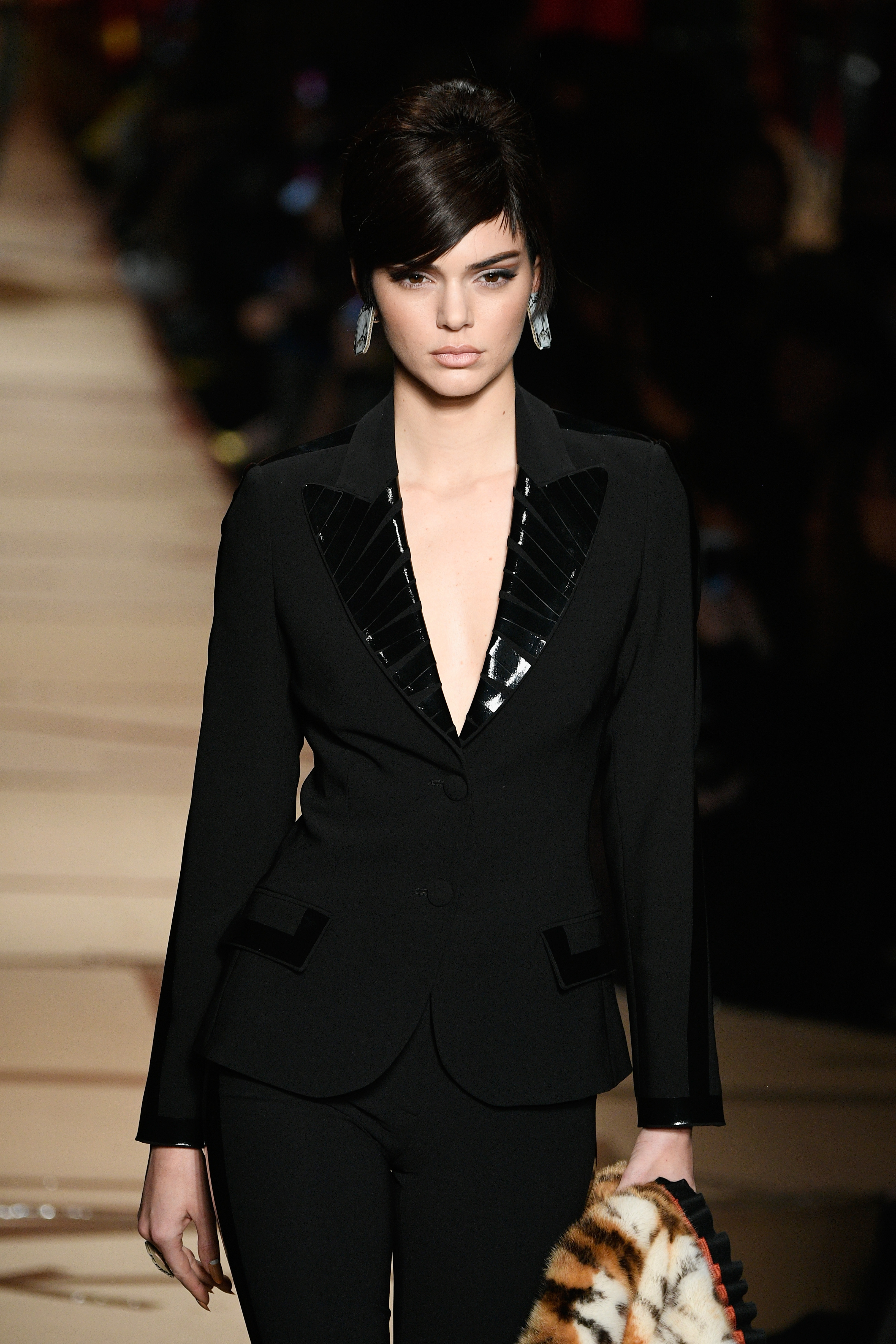"<p>When it comes to fashion the Kardashian clan's default setting is less is more, when it comes to fabric not accessories. The glittering exception to the rule is supermodel, Estee Lauder spokesmodel and free the nipple campaigner who revealed her surprising season essential on her app.</p> <p>""Blazers are the easiest coats for spring weather,"" Kendall says, as the northern hemisphere starts to heat up after a bitter winter. Memo to Kendall, they're also good for autumn (that's fall to you).<br /> Kendall has been working the trend for some months in between her regular runway gigs and has a slew of favourites. ""The black double-breasted Dior jacket I wore in Paris was a new twist that I'm loving right now and the red Magda Burtyn I put over my Gucci sweatshirt was a quick way to polish that look.""</p> <p> Here's Kendall blazing trails along with some runway stimulation for you to suit up this season.</p> <p>Moschino, A/W 17.</p>"
