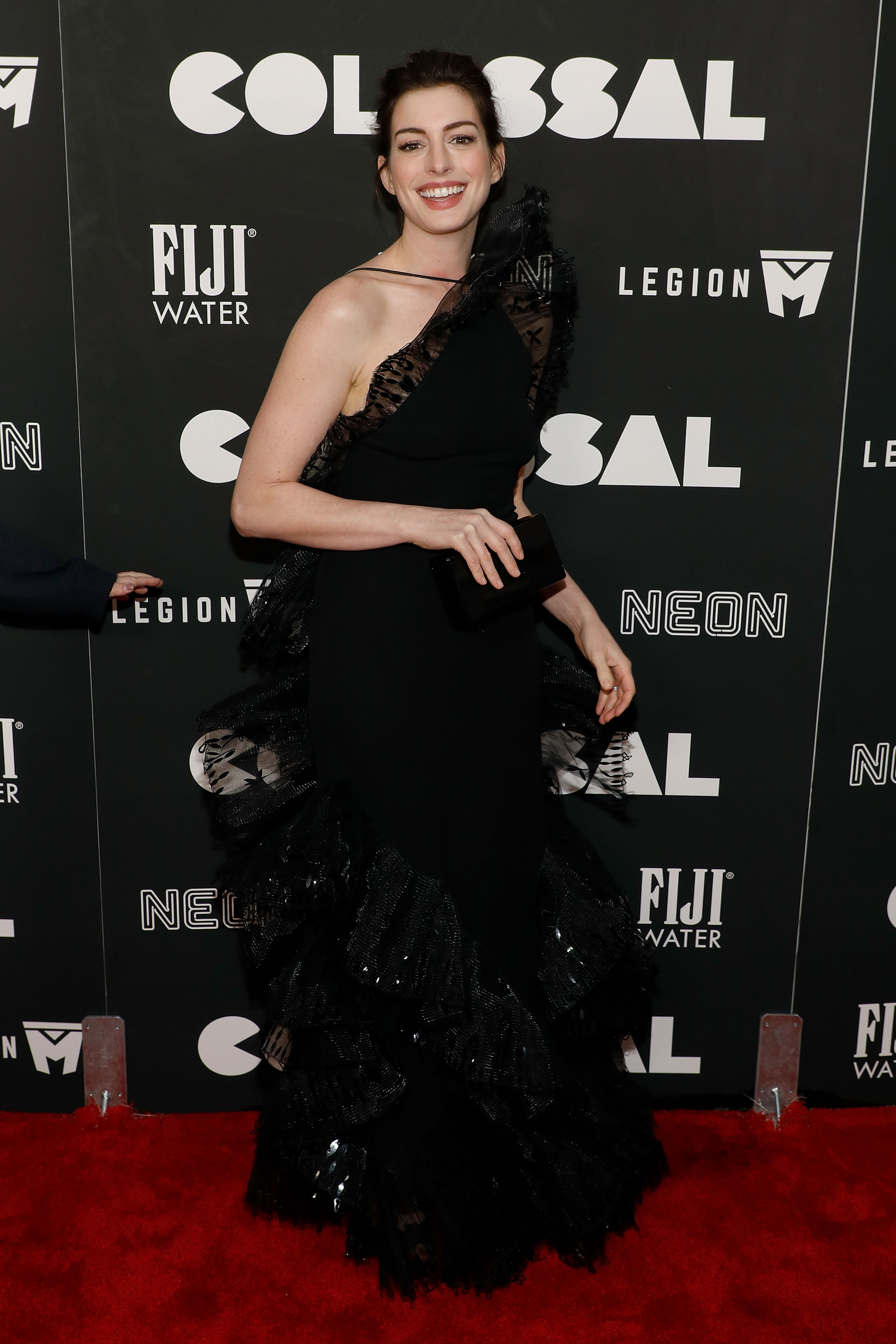 At the New York premiere of her latest movie Colossal Anne Hathaway made a statement about sustainability by having her stylist raid the Armani archives.<br /> Anne stepped out in a figure-hugging black Armani Pirve gown, with a dramatic bust line rising like Everest to her chin.<br /> Penny Lovell, Anne's stylist, has declared that the Oscar-winner will follow Emma Watson's lead and only wear outfits with a sustainable approach on the red carpet.<br /> We're hoping this means that Anne (she will always be Princess Mia to us) will drag out some of these looks from her walk-in wardrobe.