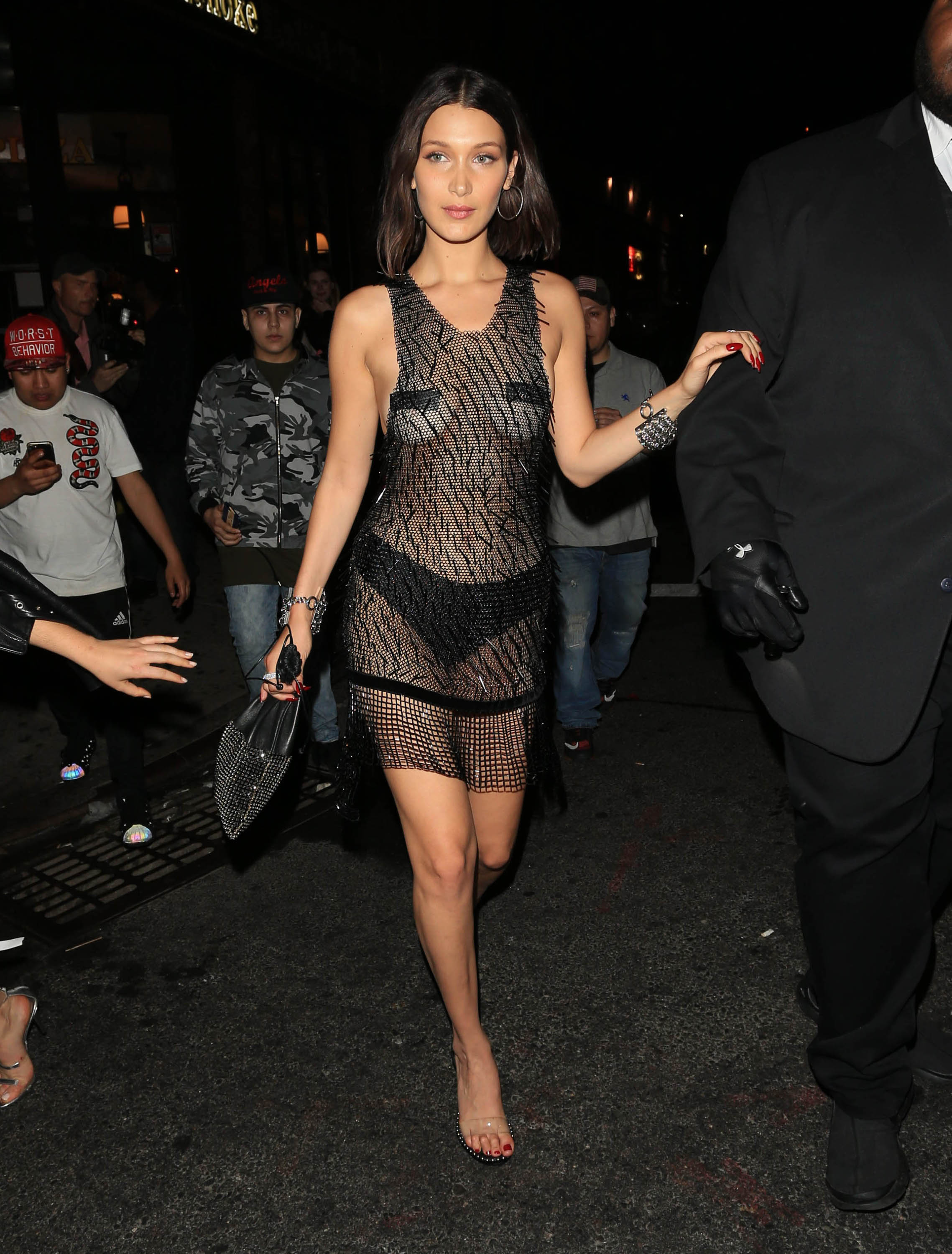 """<p>Bella Hadid was definitely in the mood to 'bare all' at the<em><a href=""""http://style.nine.com.au/2017/05/02/08/15/met-gala-red-carpet-2017"""" target=""""_blank"""" draggable=""""false"""">2017 Met Gala Rei Kawakubo/Comme des Garcons: Art Of The In-Between.</a></em></p> <p>After donning a nearly nude catsuit on the red carpet by  Alexander Wang, the supermodel went for an even more daring look for the post-met celebrations in another sheer look from the designer.</p> <p> The 20-year-old arrived at 'Queen of the night' Rihanna's after-party at New York hotspot 1OAK, in a  beaded chain-mail dress that left little to the imagination.</p> <p>But Bella wasn't the only A-lister who made a splash with their post-gala attire, as Katy Perry, Lily Aldridge and Kendall Jenner also kept the designer outfits and shock-factor flowing well into the night.</p> <p>We take a look at the A-list's Met Gala red-carpet looks and their after-party transformations.</p>"""
