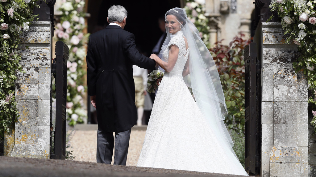 Pippa Middleton in the Giles Deacon wedding dress with her father Michael. Image: Getty
