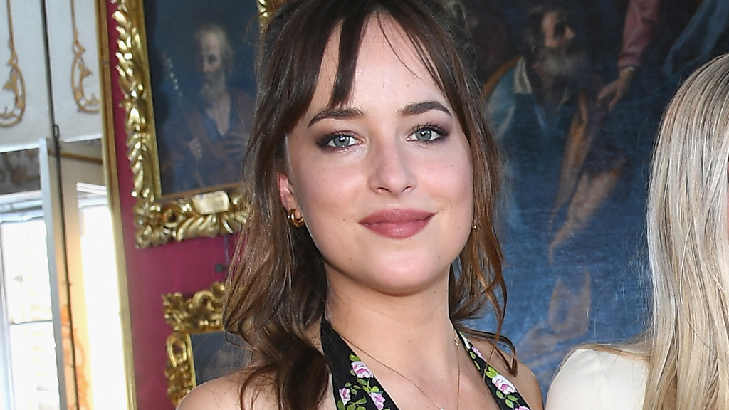 Dakota Johnson in the front row at Gucci Resort '18. Image: Getty