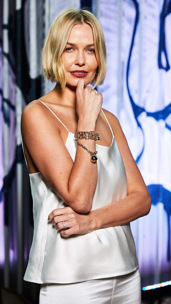 "<p><a href=""http://style.nine.com.au/2017/04/07/10/47/style_lara-worthington"" target=""_blank"">Lara Worthington</a> officially became Australia's answer to <a href=""https://style.nine.com.au/2017/04/04/17/50/lady-gaga-tiffany"" target=""_blank"">Lady Gaga</a> by hosting last night's lavish <a href=""http://www.tiffany.com.au/?gclid=Cj0KEQjw9r7JBRCj37PlltTskaMBEiQAKTzTfMlb8F-FDdRPNBG-BS1Ztue4Y_T2lTEB-_6nqFJTWsYaAvAU8P8HAQ"" target=""_blank"">Tiffany & Co.</a> celebration at Sydney's Carriageworks for the launch of the jewellery giant's HardWear collection. </p> <p> While Lady Gaga is the face of the brand internationally, Lara, 29, was called on to represent Tiffany & Co for the Australian celebration. </p> <p> Having returned to Sydney without 7-month old Racer, 2-year-old Rocket Zot and husband Sam Worthington, beauty entrepreneur and former swimsuit model, attended the event wearing a white ensemble from Australian designer Michael Lo Sordo.</p> <p> In a stylish nod to her hosts, Lara wore the $22,300 <a href="" http://www.tiffany.com.au/jewelry/necklaces-pendants/tiffany-hardwear-wrap-necklace-60700923?fromGrid=1&search_params=p+1-n+10000-c+3691980-s+5-r+-t+-ni+1-x+-lr+-hr+-ri+-mi+-pp+0+&search=0&origin=browse&searchkeyword=&trackpdp=bg&fromcid=3691980 "" target=""_blank"" draggable=""false"">Tiffany & Co HardWear Wrap Necklace</a> as a bracelet at the party.</p> <p> The appearance will be a welcome boost for Lo Sordo who has faced business difficulties that took him to court last year. </p> <p> Also attending the event to promote Tiffany's & Co.s new collection, an attempt to capture a more youthful, edgy audience were bloggers Nadia Bartel and Kate Waterhouse and Australian sister act Say Lou Lou, who performed.   <br> <br> </p>"