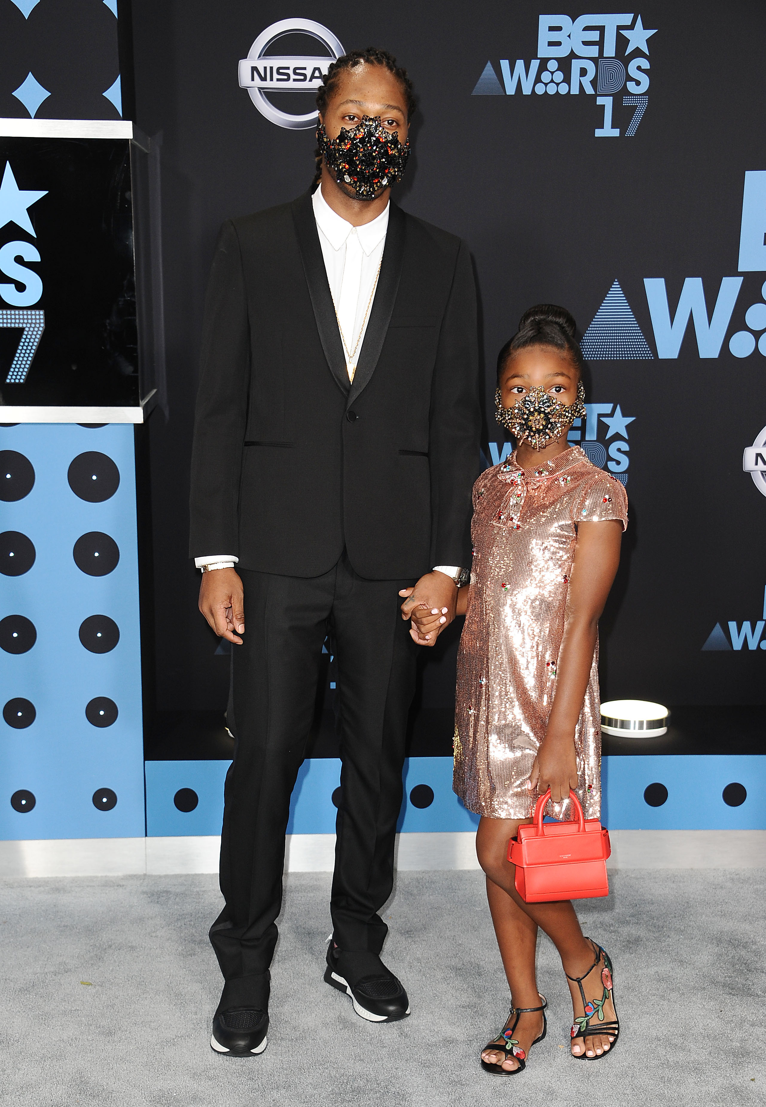 <p>With Beyonce on maternity leave, the annual BET Awards in Los Angeles took a stylish step back until rapper Future hit the red carpet with his 8-year-old daughter Londyn Wilburn in matching masks.</p> <p>The bejewelled accessories could be a less than subtle nod to the performer's hit single Mask Off but presenting a confronting image in the fashion stakes.</p> <p>Masks have appeared on the runway at Margiela in Paris and last year Toni Maticevski stunned the Australian Fashion Week front row with models wearing mouth covers but this is a first in father and daughter looks.</p> <p>Offering more conventional looks in the style stakes were Jada Pinkett-Smith in Alexandre Vauthier and Solange Knowles with striking Jennifer Fisher jewellery, on her hands rather than her face.  </p>