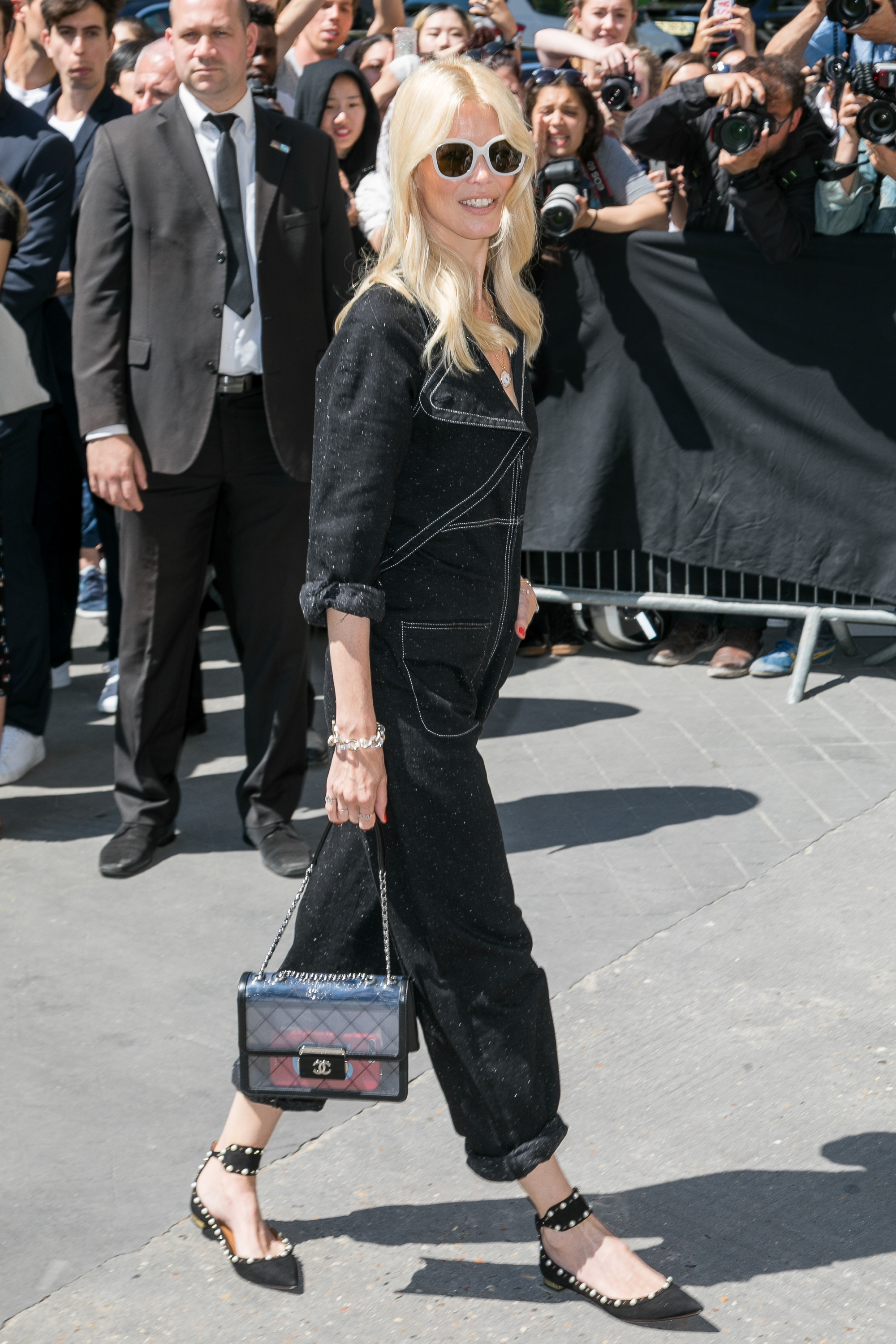 "<p>The <a href=""http://style.nine.com.au/2017/06/01/12/27/sistine-stallone-chanel-tokyo-lily-depp"" target=""_blank"">Chanel</a> show in Paris on Tuesday drew the haute couture and Hollywood A-list but it was Claudia Schiffer, 46, in a denim jumpsuit that showed the title of 'supermodel' doesn't disappear when you retire from the runway.</p> <p> In white sunglasses the German who rose to fame as a Guess campaign girl, going on to become one of Karl Lagerfeld's muses in the '90s, was an understated blonde bombshell, standing out from the peroxide pixie crop pack of pop singer Katy Perry, Kristen Stewart and Cara Delevingne.</p> <p>While there were some adventurous front row outfits, with Kristen dressed in a reflective sleeveless jumpsuit looking as though she had stepped of the Studio 54 dancefloor, Karl kept things understated in his runway tribute to the Eiffel Tower.</p> <p>See the battle of the blondes and other shades of success here.</p> <p> </p>"