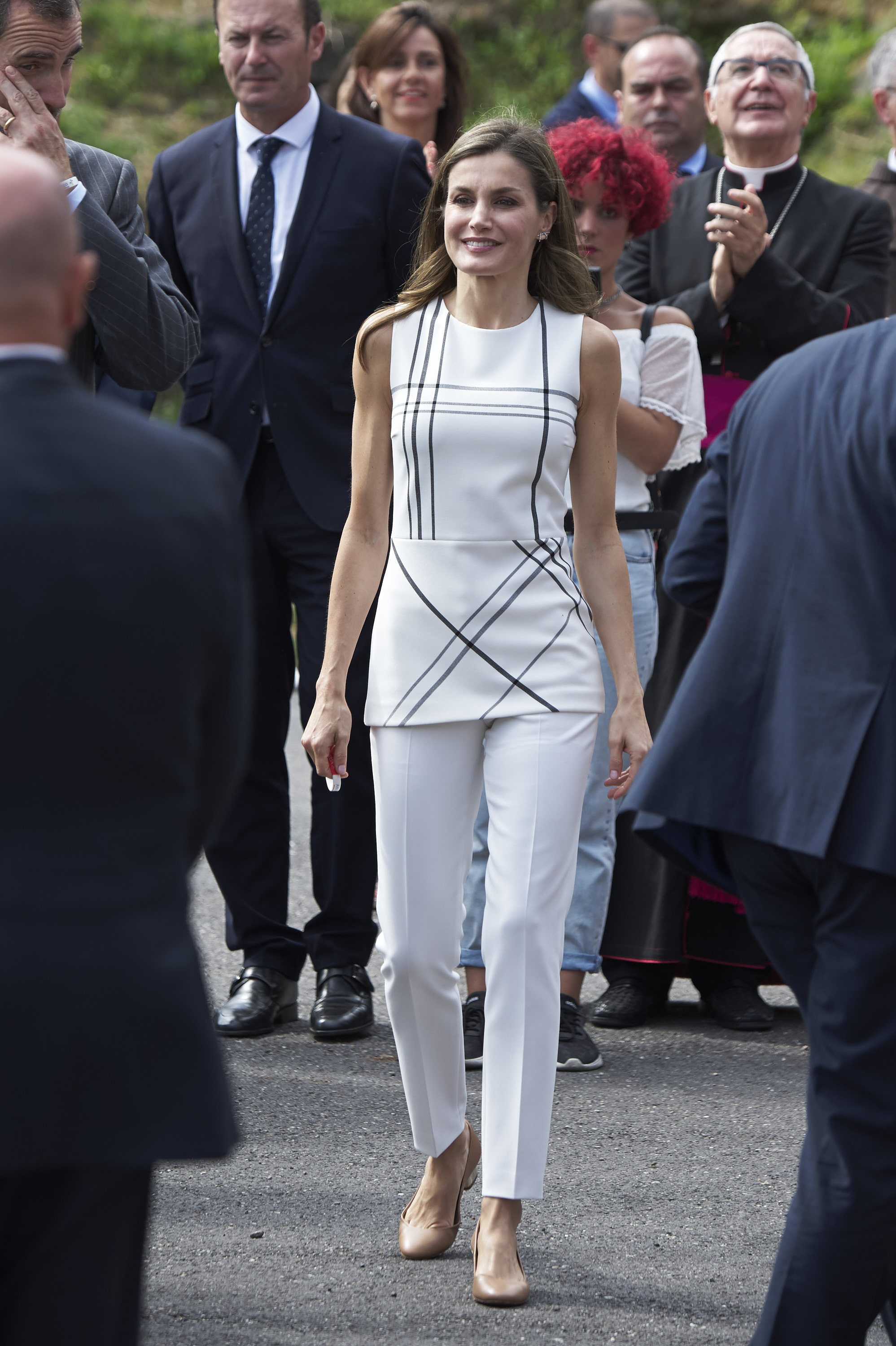 <p>After dazzling the royal family on a state visit to the UK last week, Queen Letizia of Spain is back on home soil and marking her territory with head-turning fashion once more. </p> <p>Appearing at the Santo Toribio de Liebana Monastery in Camaleno with her husband King Felipe VI, Letizia stepped out in a head-to-toe white outfit by Hugo Boss.</p> <p>The tailored cigarette pants and tunic top with a light check motif have been worn before by the Spanish Queen, she donned the designer top last year in Madrid at the 2016 Accion Awards in September.</p> <p>And it's not just Letizia's ability to recycle outfits that are part of her sartorial appeal.</p> <p>Burberry, Prada and Carolina Herrera are just some of the designer names the former newsreader donned during her recent trip to the UK which saw her stepping out in polished pencil skirts, fitted blouses and chic sun dresses.</p> <p>The Spanish Queen's ability to mix and match budget pieces from stores such as Zara and Mango with edgy couture attire has impressed fashion fans all over the world.<br> <br> Click through to see some of the recent fashion wins of Queen Letizia of Spain.</p>