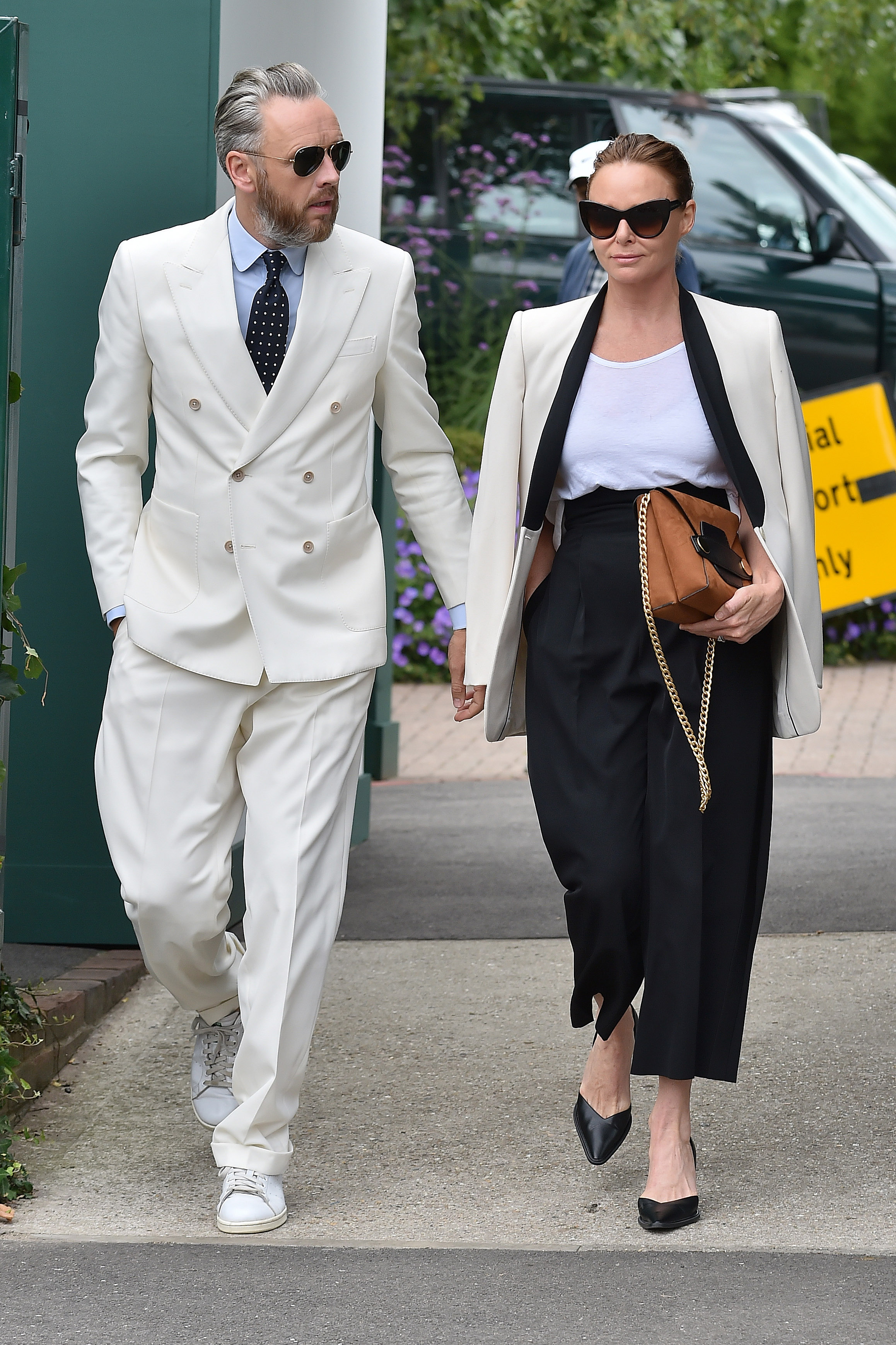 "<p><a href=""https://style.nine.com.au/stella-mccartney"" target=""_blank"" draggable=""false"">Designer Stella McCartney</a> and her husband, Alashdair Willis, solidified their status as a couple with serious sartorial flair at <a href=""https://style.nine.com.au/2017/07/17/10/33/style_kate-and-pippa-wimbledon-style"" target=""_blank"" draggable=""false"">Wimbledon last week </a>in matching his-and-her suits.</p> <p>Stella's take on the power suit saw her pair a monochrome blazer and high-waisted black pants of her own design with a casual white t-shirt and caramel-coloured clutch.</p> <p>Her publisher husband matched his wife's style status in a crisp, white double-breasted suit with a pair of white sneakers adding a casual element to the look.</p> <p>The couple's co-coordinating attire was a modern and innovative twist on classic Wimbledon whites and proved that a suit isn't just exclusive to red carpets or the boardroom.</p> <p>Whether they're Hollywood superstars, sport stars or fashion industry powerhouses, many style-savvy A-list couples haven't been afraid to make a splash in his-and-her suits.</p> <p>Click through to see the the A-list couples who have suited up in style.</p>"