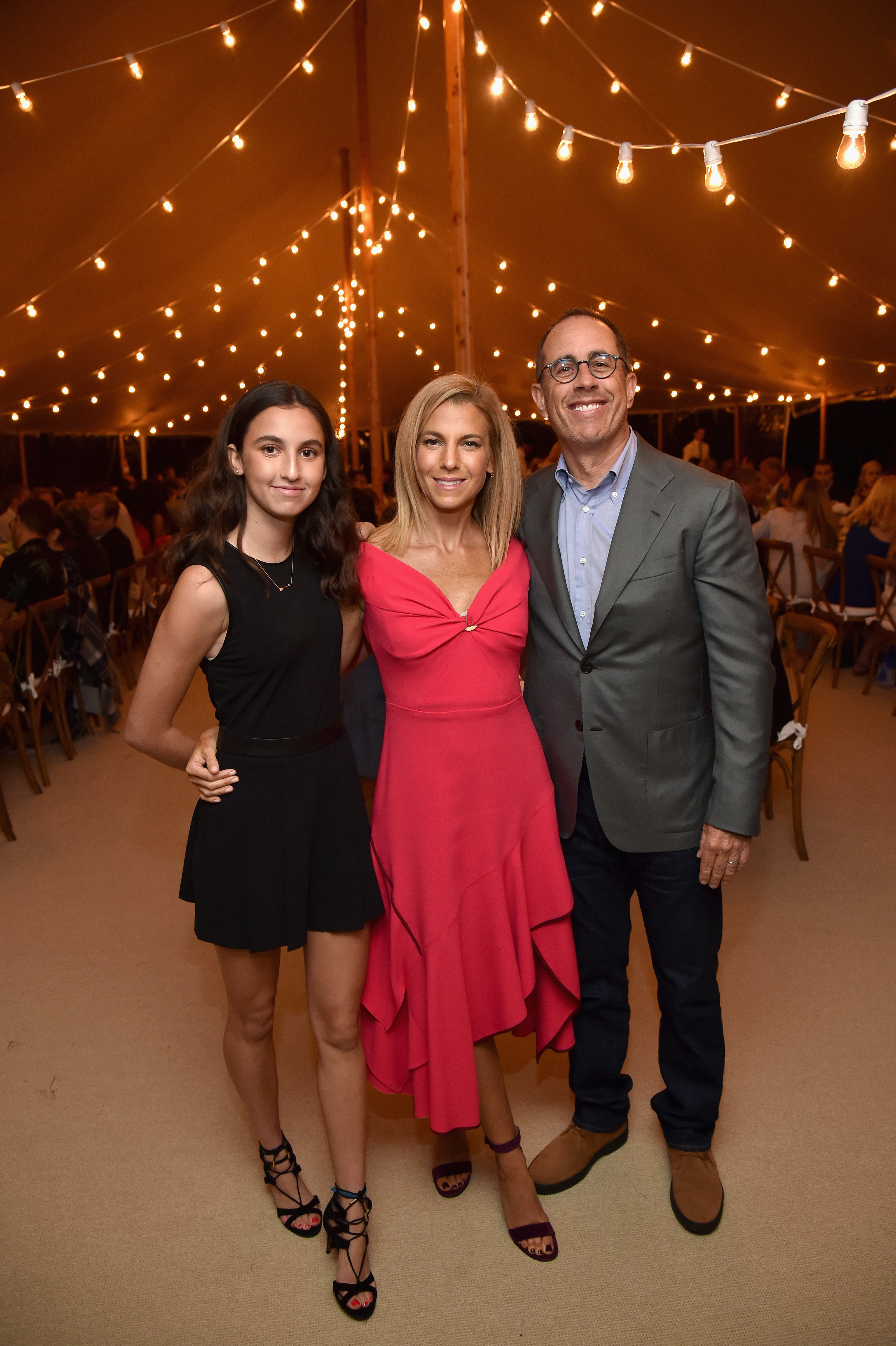 "<p>In our memories television's Seinfeld was the perennial single but at a Net-a-porter event comedian Jerry Seinfeld showed that married life continues to suit him, sitting alongside his 16-year-old daughter Sascha.</p> <p>The fresh-faced, petite brunette didn't have to travel far with the party held in conjunction with the foundation GOOD+, which was created by Jerry's wife of 20 years, Jessica Seinfeld, held at the family's Hamptons estate.</p> <p>For two weeks Net-a-porter has arranged a pick-up service for the premium customers in the US to donate children's books and clothing.<br> ""Are there any women here who have heard of Net-a-port-er?"" Jerry deadpanned to crowd according to <a href=""http://wwd.com/eye/parties/jessica-seinfeld-dinner-net-a-porter-good-east-hampton-10954071/"" target=""_blank"" draggable=""false"">WWD</a>.<br> The event turned into a nostalgic television reunion with Suddenly Susan's Brooke Shields, Sabrina the Teenage Witch's Melissa Joan Hart and My Girls's Anna Chlumsky supporting the stylish cause.</p> <p> </p>"