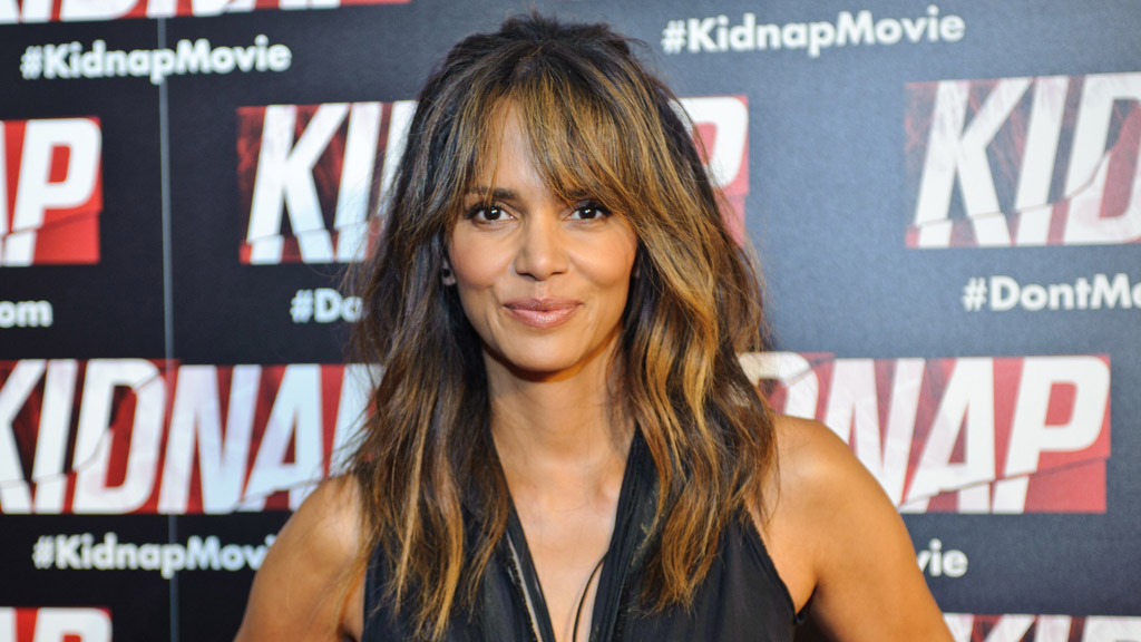 Halle Berry suffers embarrassing wardrobe malfunction in loosely-fitted blouse