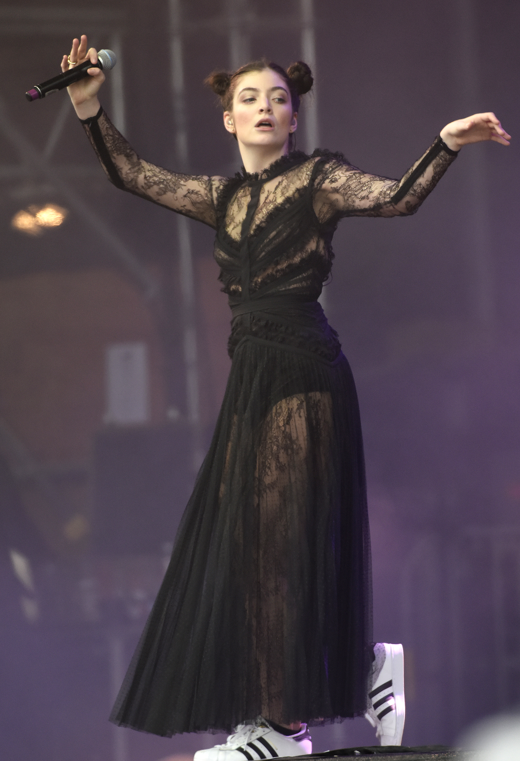 """<p>New Zealand singer <a href=""""https://style.nine.com.au/2017/08/07/11/30/lorde-handsmaids-tale-trend"""" target=""""_blank"""">Lorde </a>achieved international fame as a fashion underdog singing about <em>Royals</em> but recent appearances from this unique talent promoting her latest album <em>Melodrama</em> suggest a style shift.</p> <p>We have already clocked her <em><a href=""""https://style.nine.com.au/2017/08/07/11/30/lorde-handsmaids-tale-trend"""" target=""""_blank"""">Handmaid's Tale</a></em> cloak from New York label Vaquera plus Jacquemus and Zandra Rhodes' ensembles in the video for Perfect Places but at San Francisco's Outside Lands Festival Lorde took another aesthetic leap forward.</p> <p>The black lace dress from Elie Saab that Lorde performed in touched on her Gothic roots but was another clear signal that she's exploring her glamorous side.</p> <p>While the singer once made slouchy tracksuits and athletic tops her signature look, star stylist Karla Welch, who works with Justin Bieber, Katy Perry, Karlie Kloss and <a href=""""http://style.nine.com.au/2017/01/10/09/58/ruth-negga-louis-vuitton-dress"""" target=""""_blank"""">Ruth Negga</a>, has given the intense 20-year-old an introduction to luxury labels.</p> <p>While it's exciting watch Lorde's style evolution, we still take some glee in seeing that she kept her Adidas sneakers on beneath the feminine dress.<br> <br> <br> </p>"""