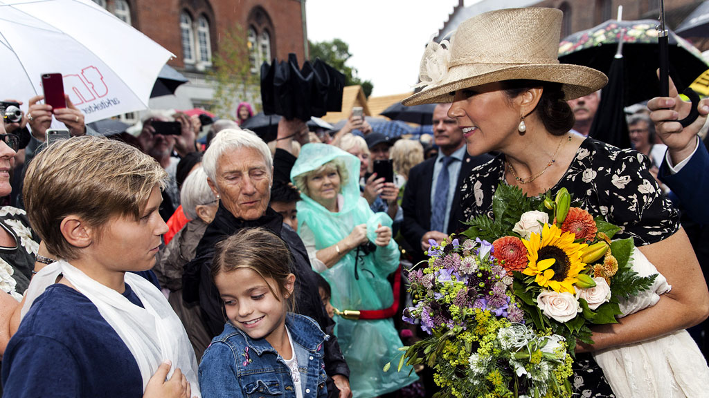 """<p>Princess Mary stepped out in a chic black-and-white Ralph Lauren dress to open the annual flower festival in the Danish town of Odense. The show celebrates urban gardening and has 100,000 plants on display over the period of the festival. </p>                                                                     <p>Accepting flowers from smiling children, Princess Mary enjoyed a somewhat happier occasion than the last time she appeared in public, on her younger children's <a href=""""http://honey.nine.com.au/2017/08/16/10/27/princess-mary-children"""" draggable=""""false"""">first day of school</a>earlier this week,when one of her sons burst into tears with nerves. </p>                                                                     <p>Princess Mary was born in Hobart and used to work in advertising for upmarket real-estate agency Belle Property. She is the mother of six-year-old twins Princess Josephine and Prince Vincent, Princess Isabella, 10 andPrince Christian, 11 - so her youngest's tears were no trouble. The experienced mother simply wiped them away and soothed Prince Vincent, who soon settled down and headed off to his new life at school. </p>                                                                     <p>Mary Donaldson, as she was then, met Crown Prince Frederik of Denmark in a Sydney bar, the Slip Inn, during the  Olympics in September 2000, without knowing his identity. The pair enjoyed a <a href=""""http://honey.nine.com.au/2017/05/12/10/08/princess-mary-prince-frederik"""" draggable=""""false"""">fairytale romance</a>and Mary moved to Denmark to be with Frederik in December 2001. The couple became engaged in October 2003 and married in May 2004 in Copenhagen Cathedral. Princess Mary wore an ivory satin gown by Danish designer Uffe Frank and a tiara that was a gift from her new parents-in-law, Queen Margrethe and Prince Henrik. The royal family call the imposing Amalienborg Palace in Copenhagen home.</p>"""