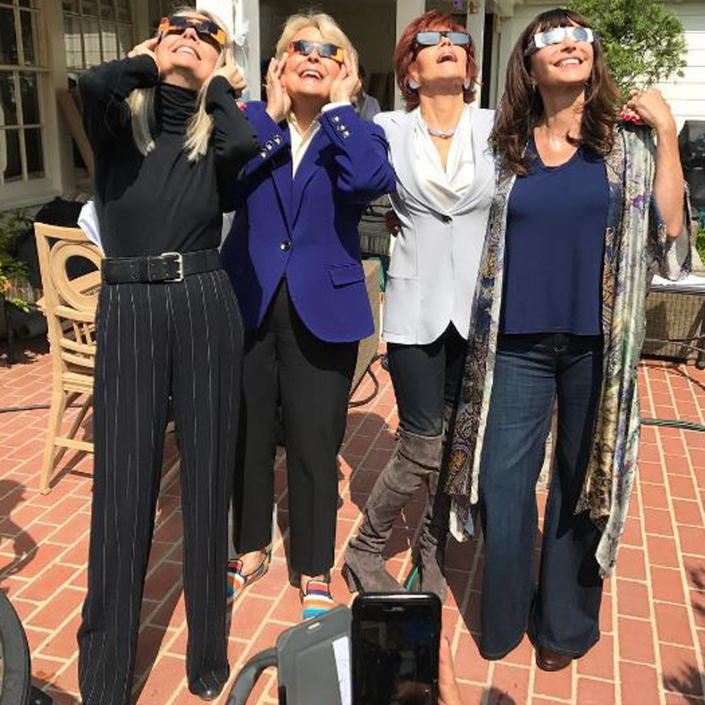 Candice Bergen, 71, Jane Fonda, 79, Diane Keaton, 71, and Mary Steenburgen, 64, have more in common than their upcoming movie <em>Book Club</em>.<br /> These four women who gathered together to watch the solar eclipse in the northern hemisphere have all discovered the enduring appeal of a well-cut blazer. Bergen posted the fun photograph to her Instagram account.<br /> Trim tailoring and some serious structure is a wardrobe staple for nights on the town or mornings in the office.<br /> The going out blazer has made a return thanks to Balmain but for these actresses it never really went away. <br /> Take it from the experts, who play women reading 50 Shades of Grey in their book club in the upcoming comedy, to see how a blazer is light years ahead of boleros and belted trench-coats when it comes to versatility.